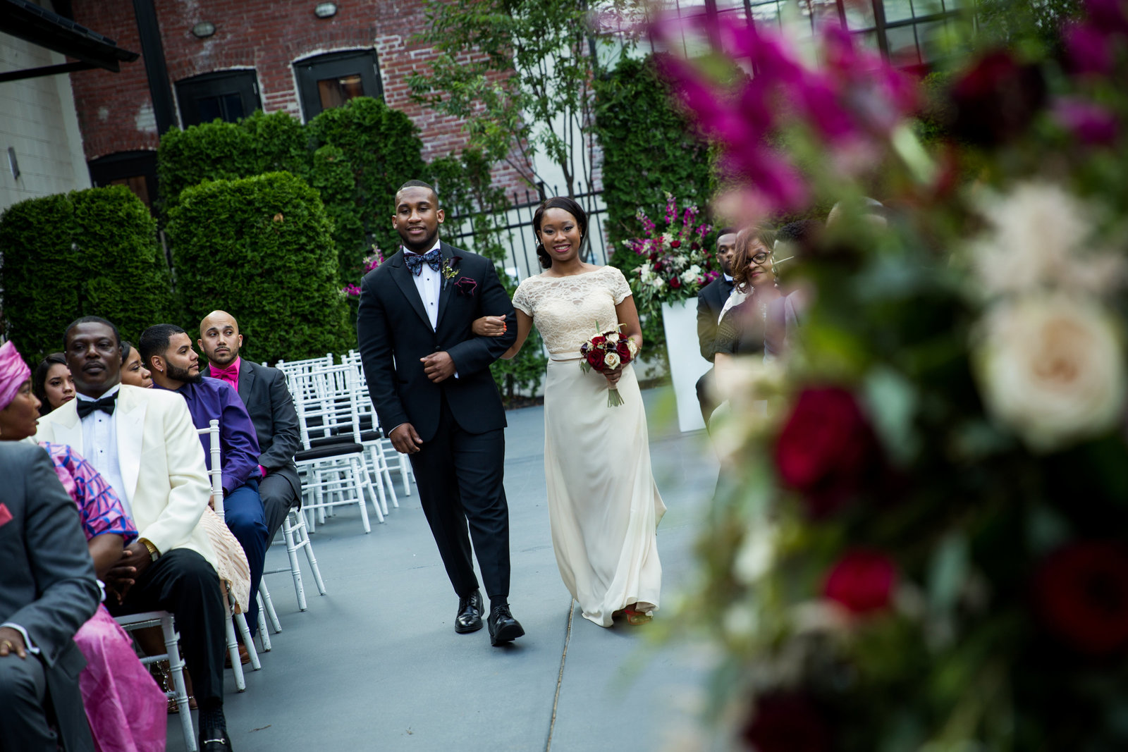 Wedding ceremony at Vie Philadelphia floral design by Carl Alan Floral  photos  by Greg Davenport Photography