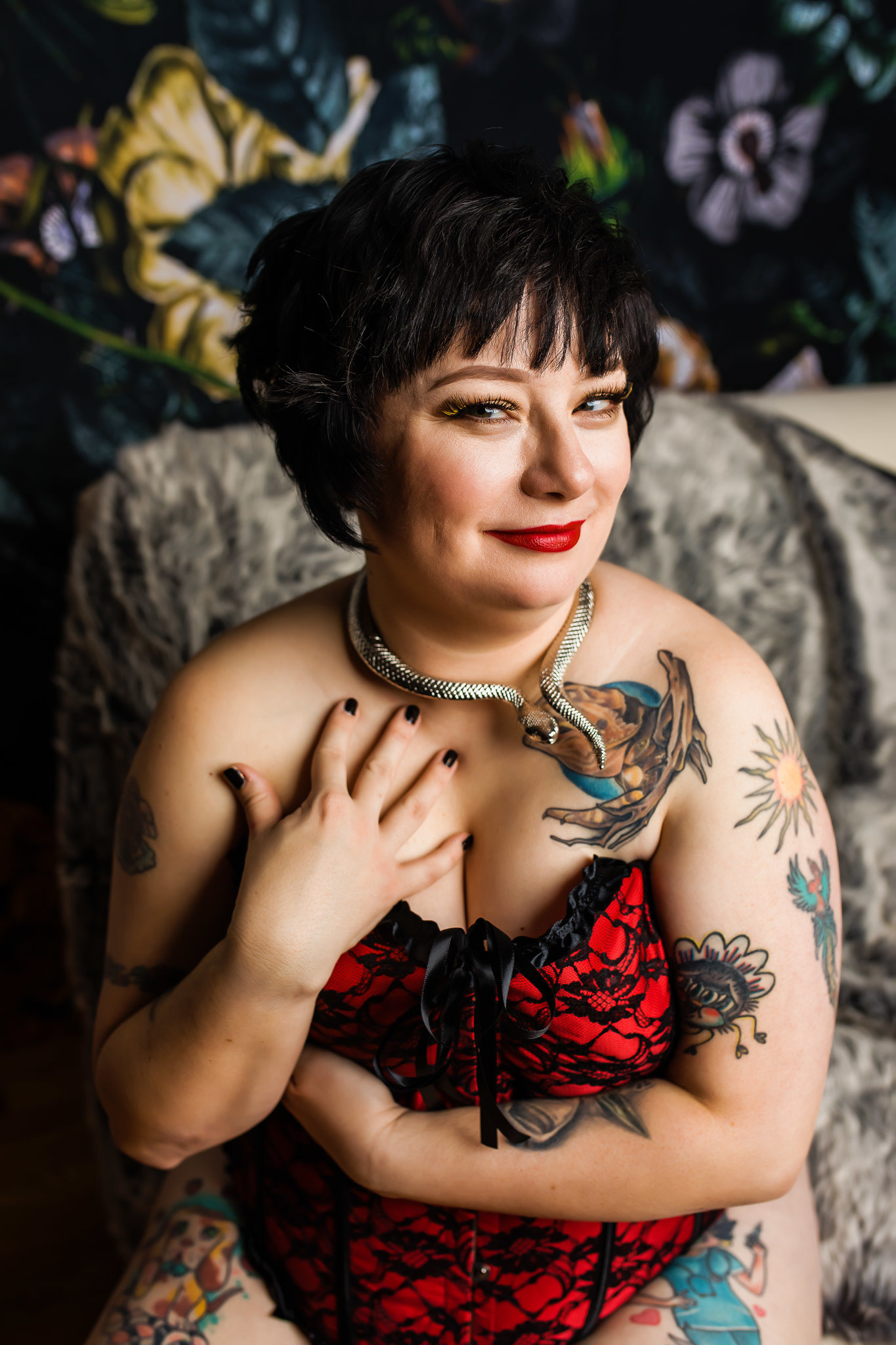 Boudoir photo of a sassy woman wearing a red corset