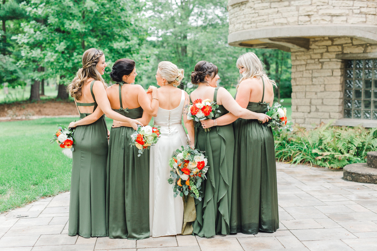 olive green bridesmaids dresses and orange florals in Iowa City