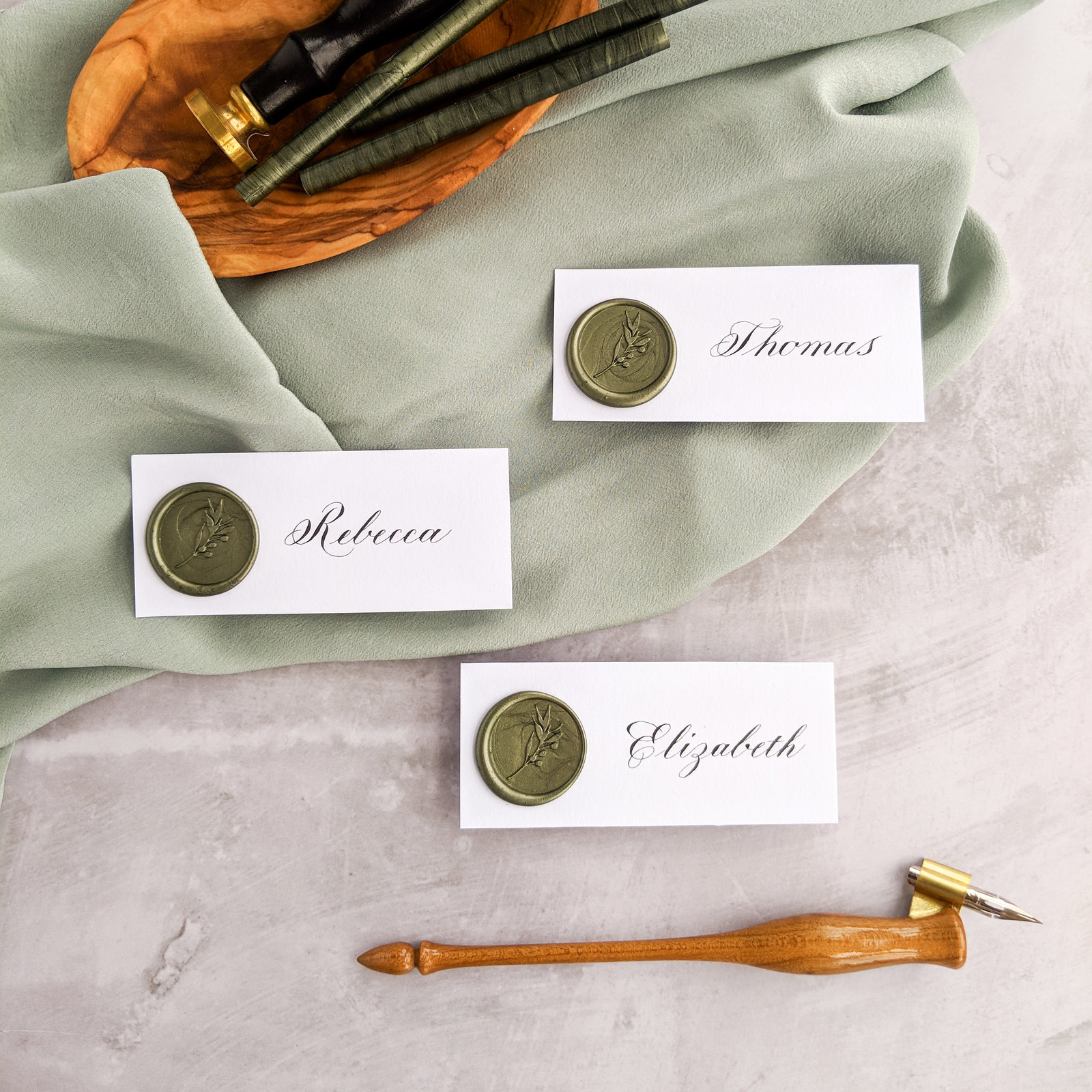 Copperplate calligraphy with olive green wax seal