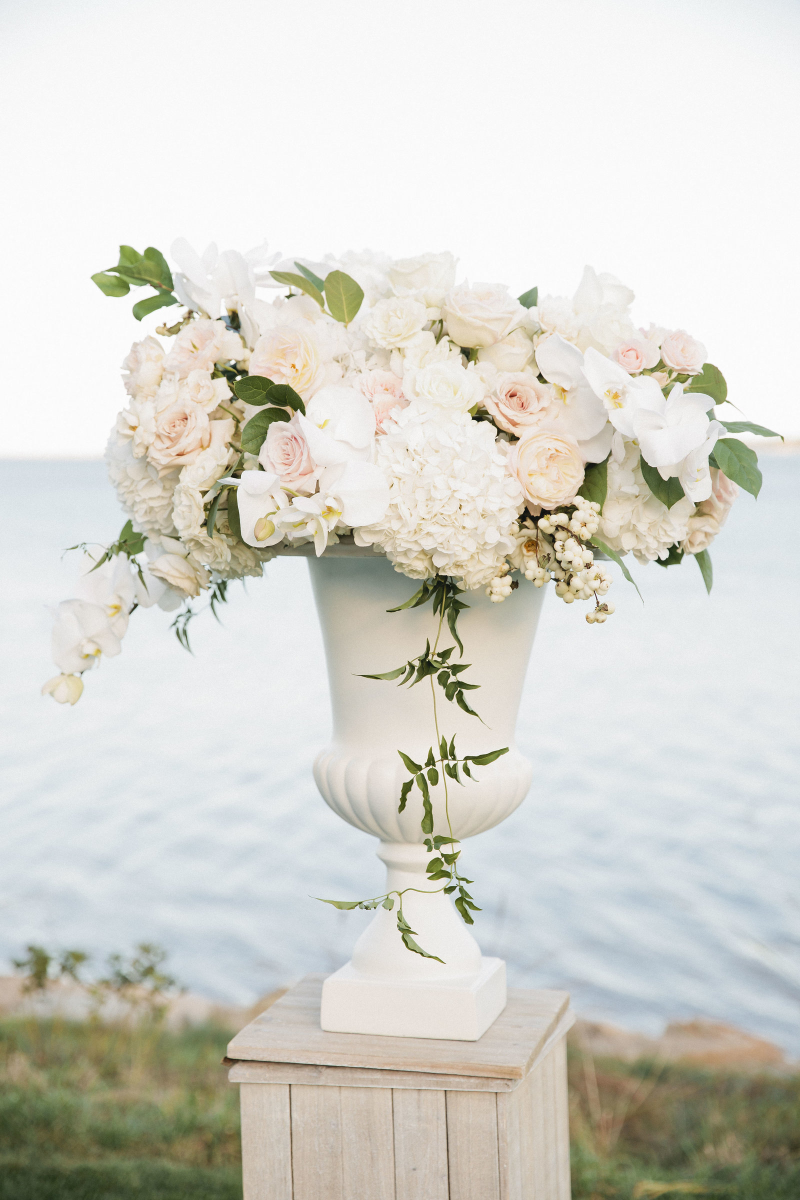 Ceremony floral urns on pedestals for coastal wedding at Wequassett Resort