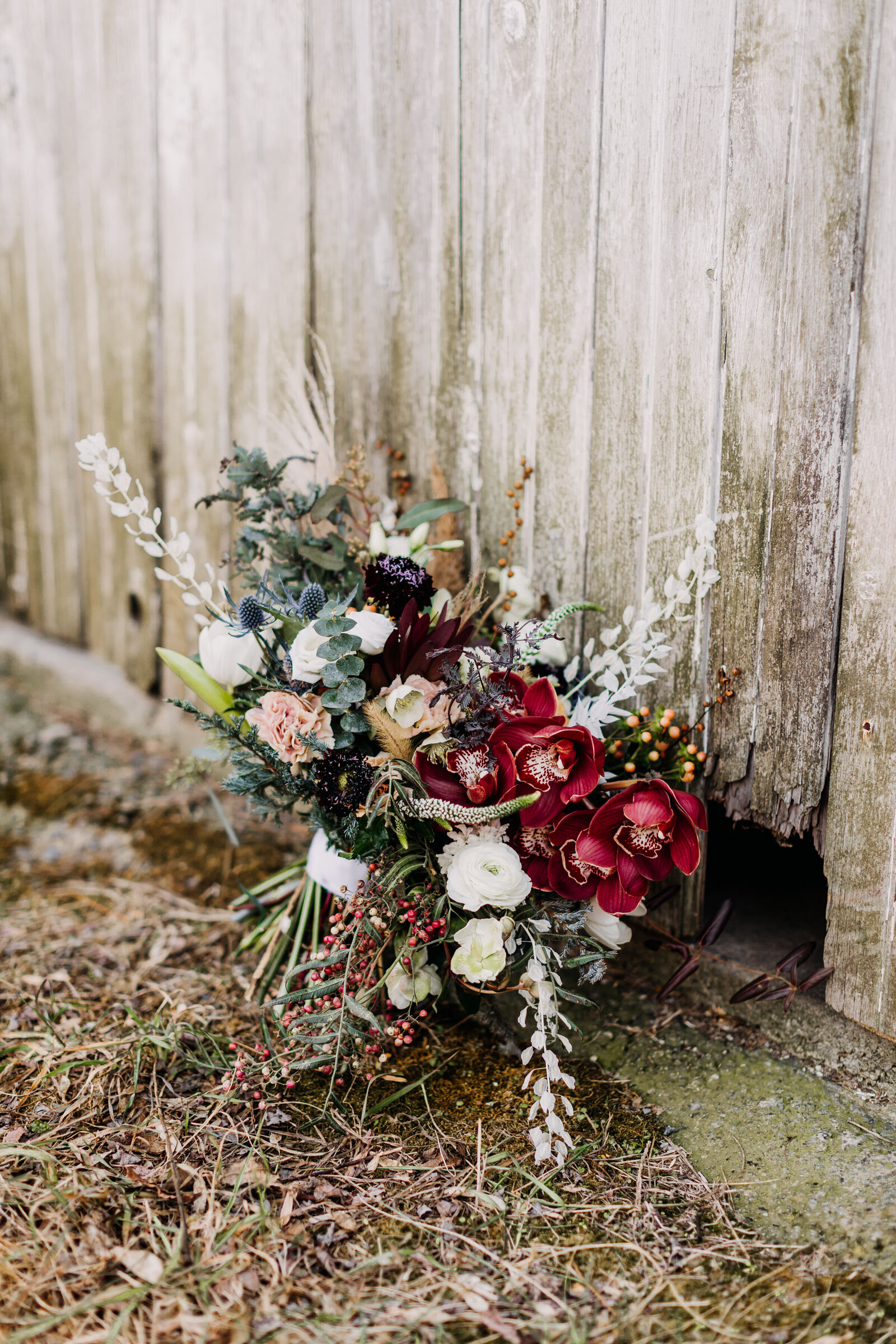 bridal flower bouquet at old rustic barn