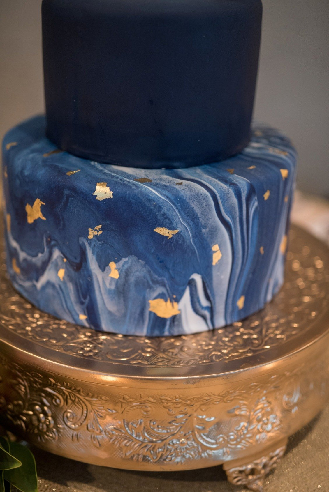 Blue, navy and white wedding cake with marble details and gold foil