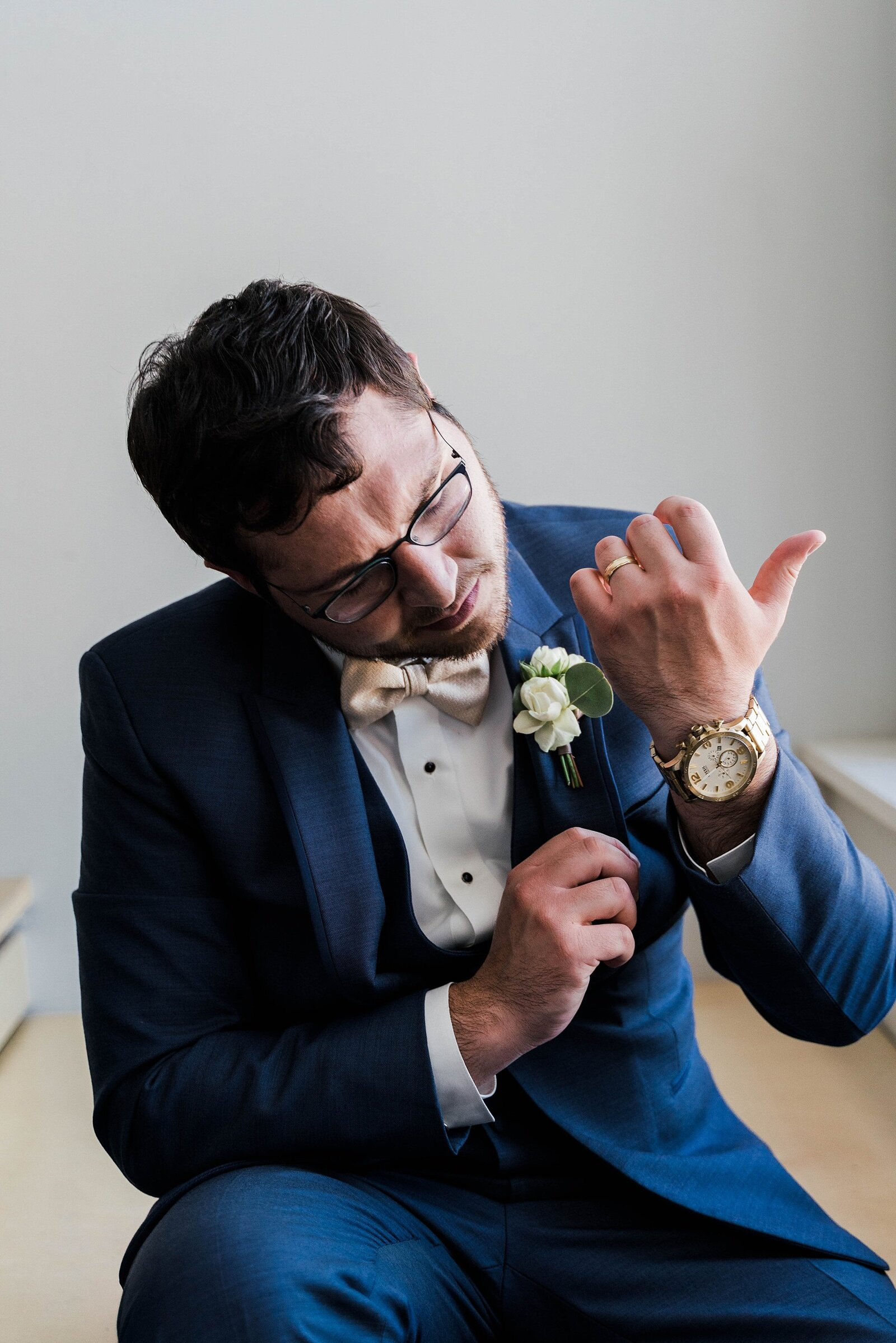 Groom adjusts his cufflinks