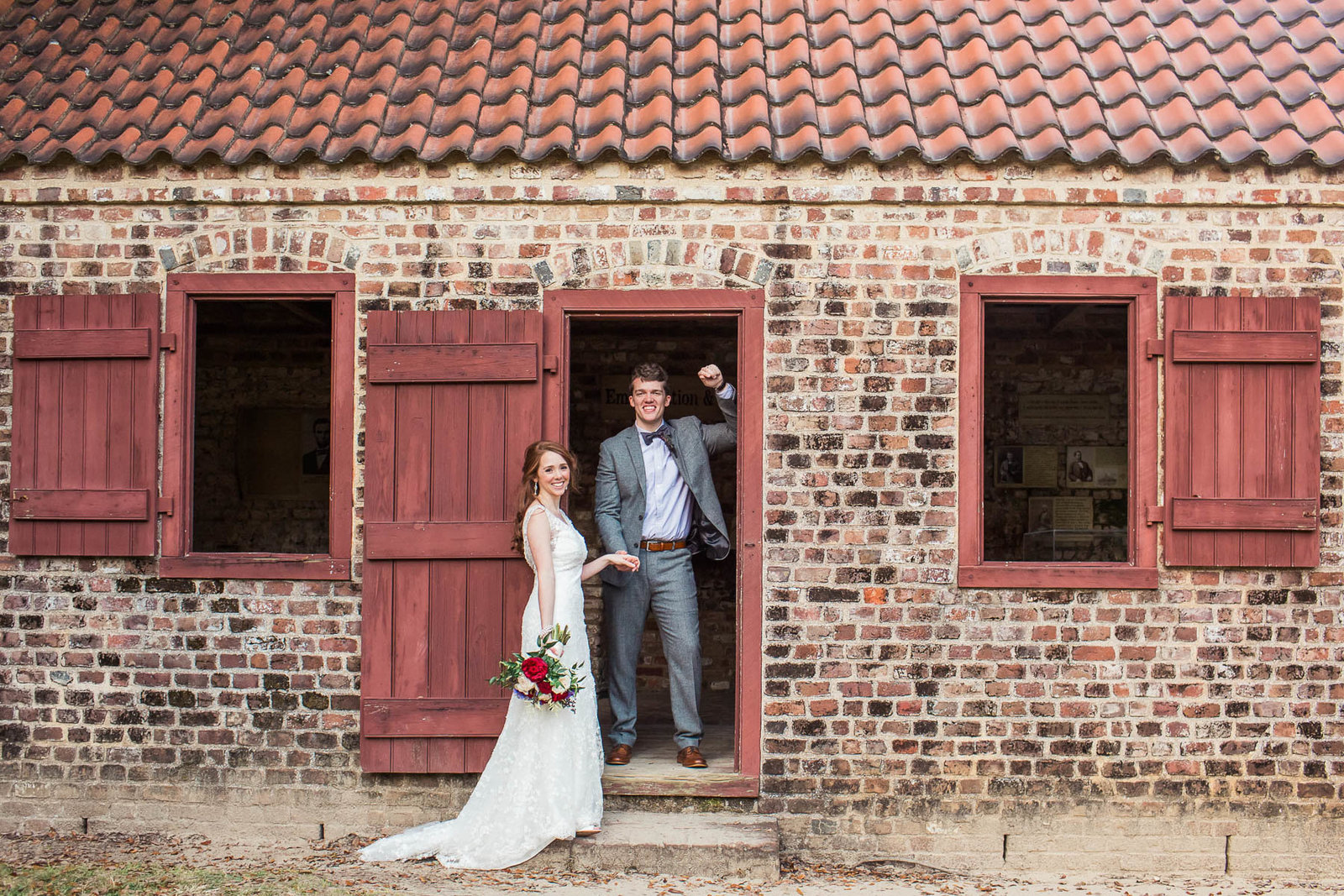 Bride and groom pose together in brick building, Boone Hall Plantation, Charleston, South Carolina