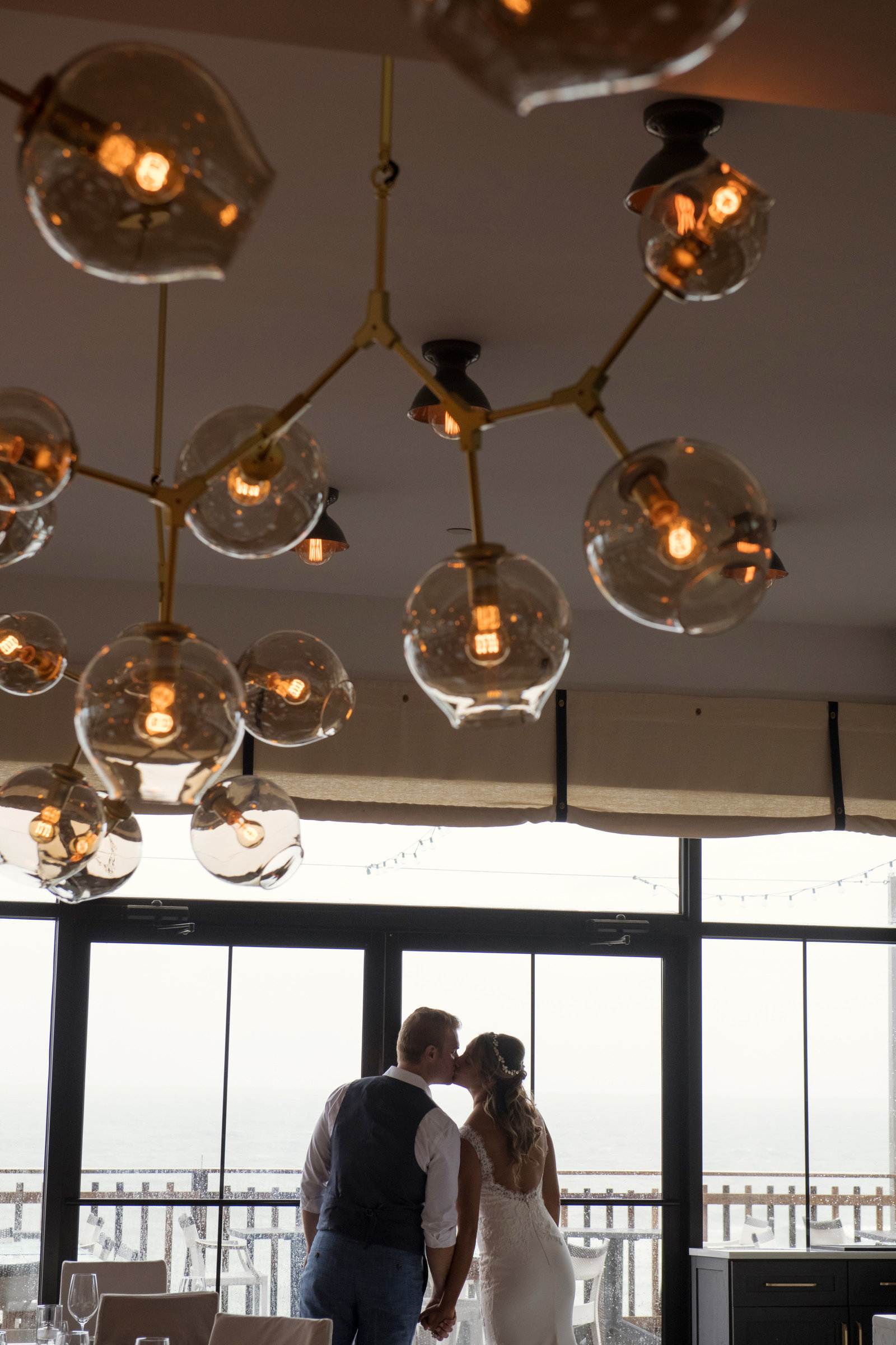 photo of bride and groom kissing inside Gurneys Montauk Resort wedding
