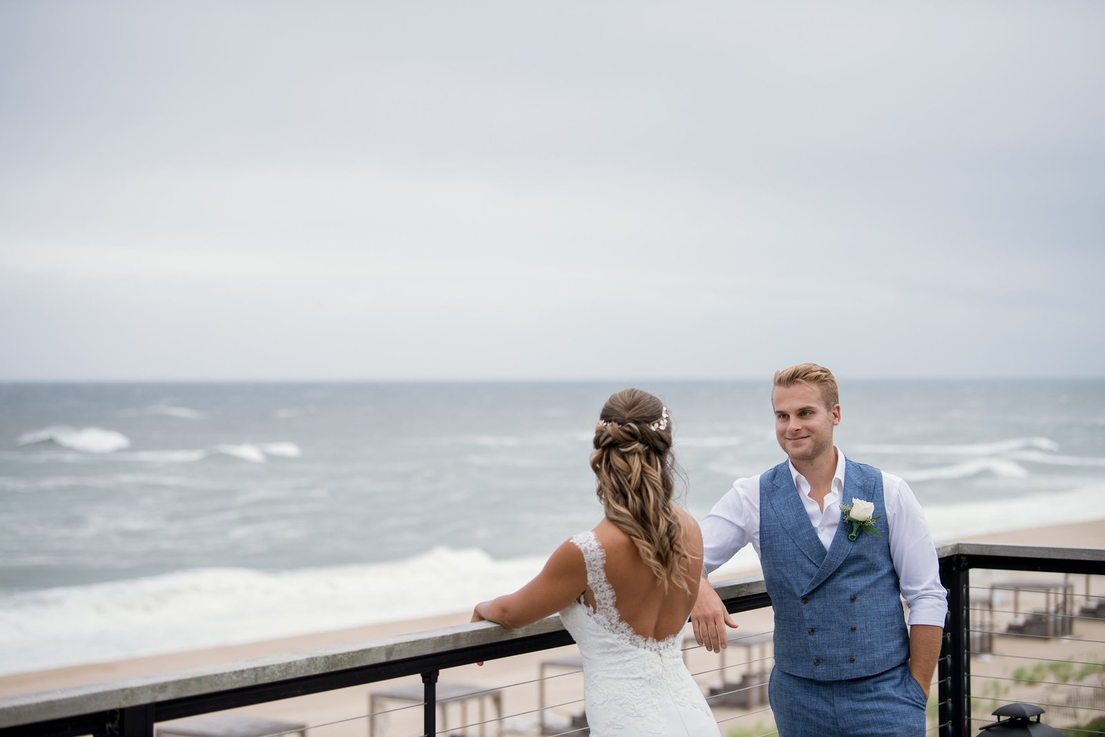 photo of groom looking at his bride from Gurneys Montauk Resort wedding
