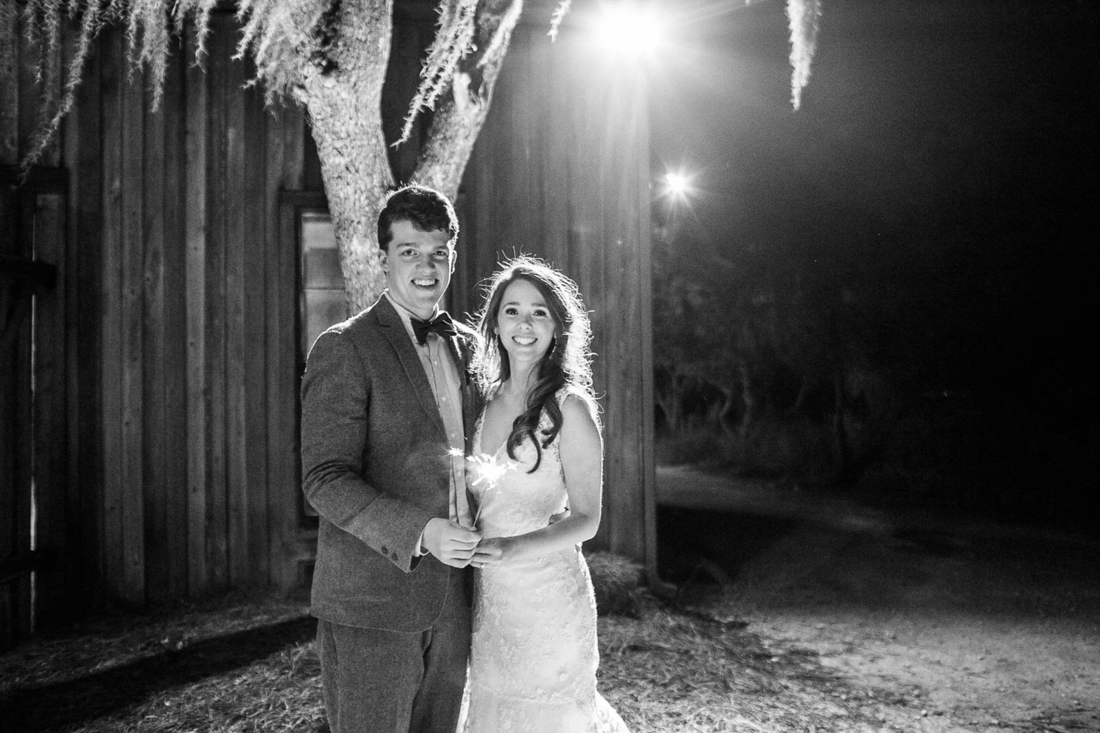 Bride and groom stand outside at night, Boone Hall Plantation, Charleston, South Carolina