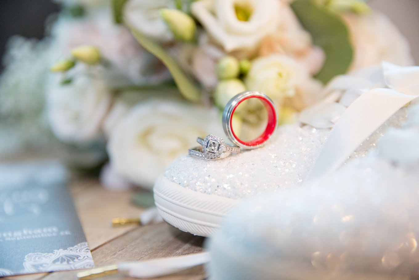 Siesta Key Wedding Photography detail shot of the rings, brides shoe's and bouquet