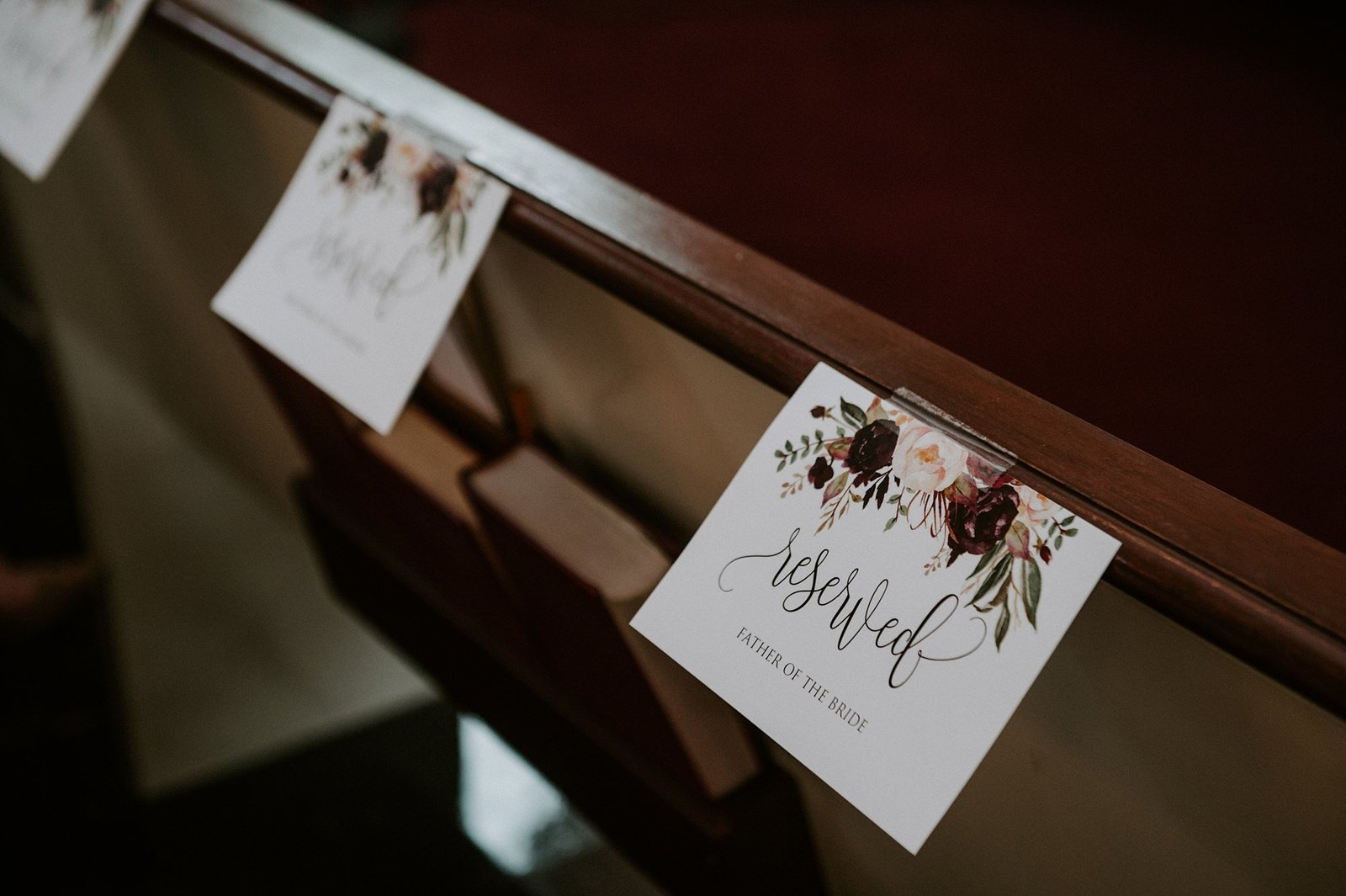 Church pew reserved wedding signs in rustic design