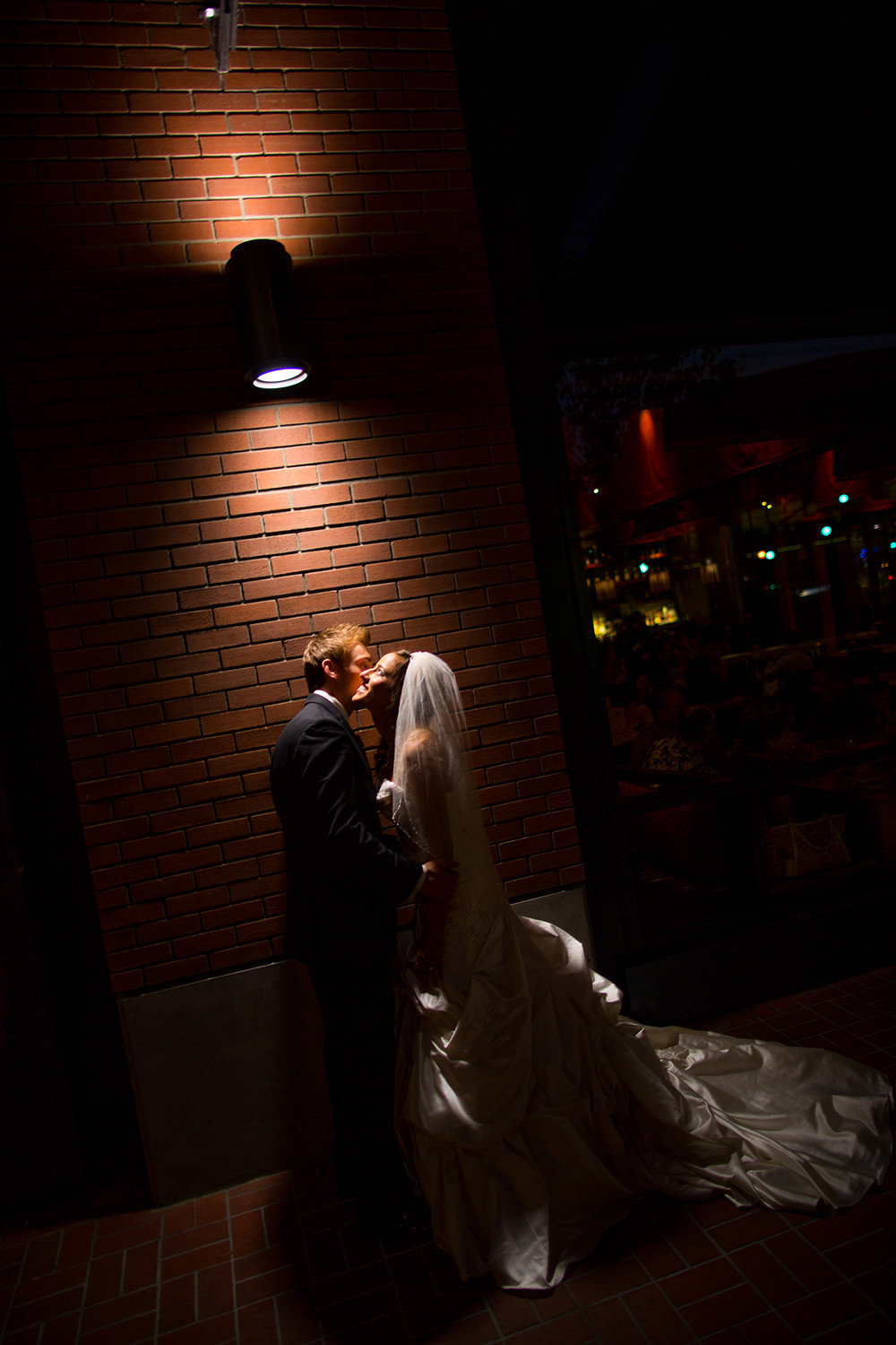 dramatic night shot with bride and groom
