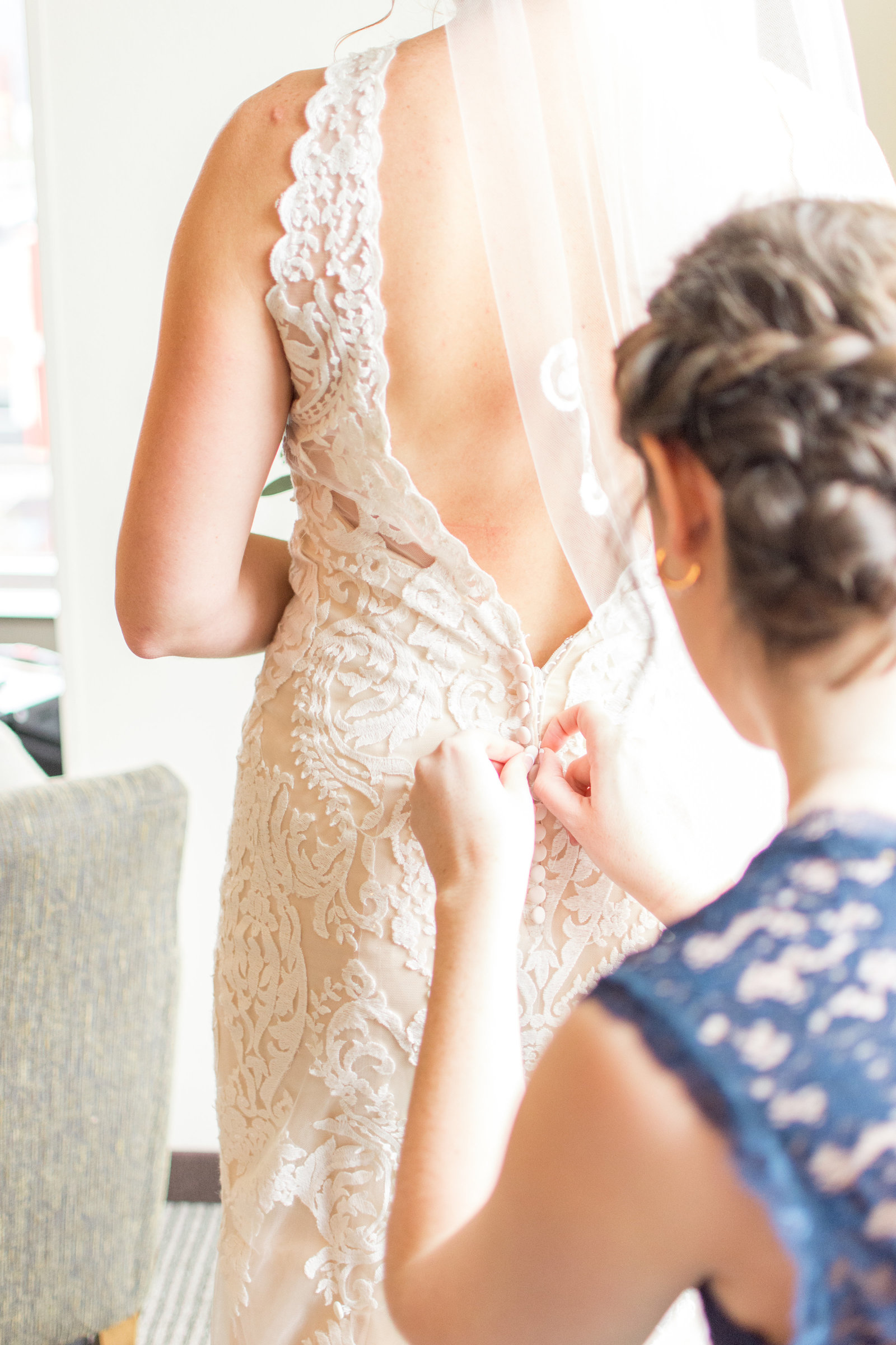 Buttoning Bride's Dress