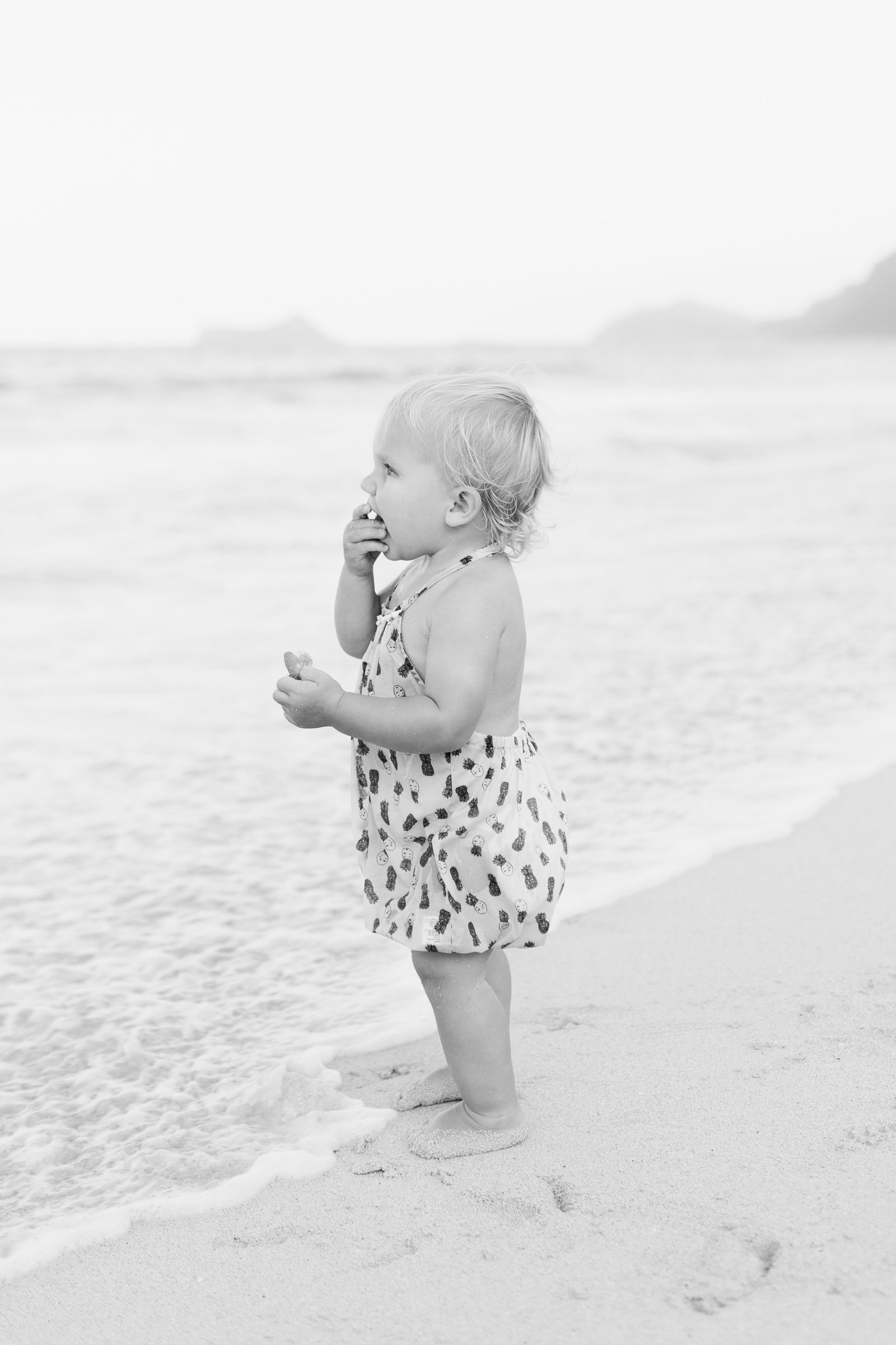 Oahu, Hawaii Lifestyle Photographer - Lifestyle Photography - Brooke Flanagan Photography - Black and White image of little girl on the beach
