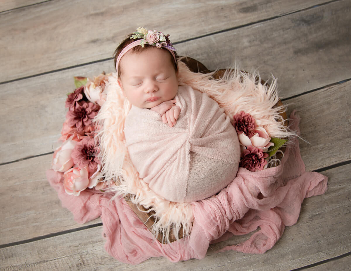 Pretty baby girl wrapped at our studio in Greece, Ny.