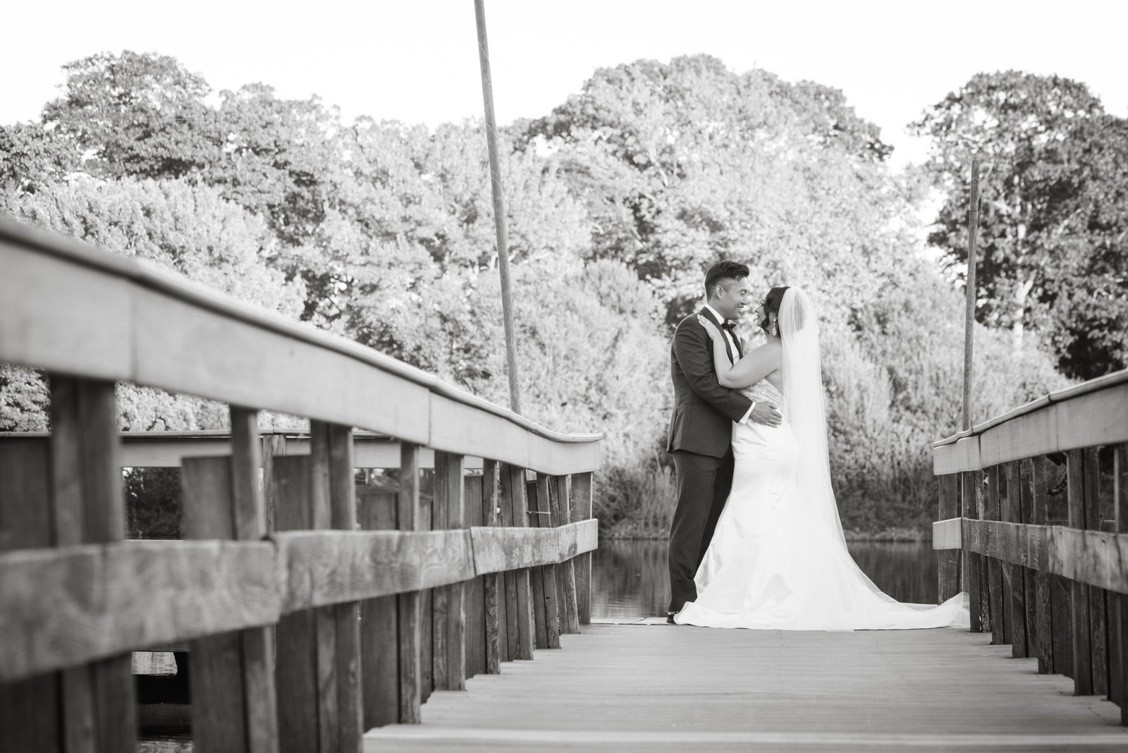 Bride and groom on dock at Camp Pa-Qua-Tuck