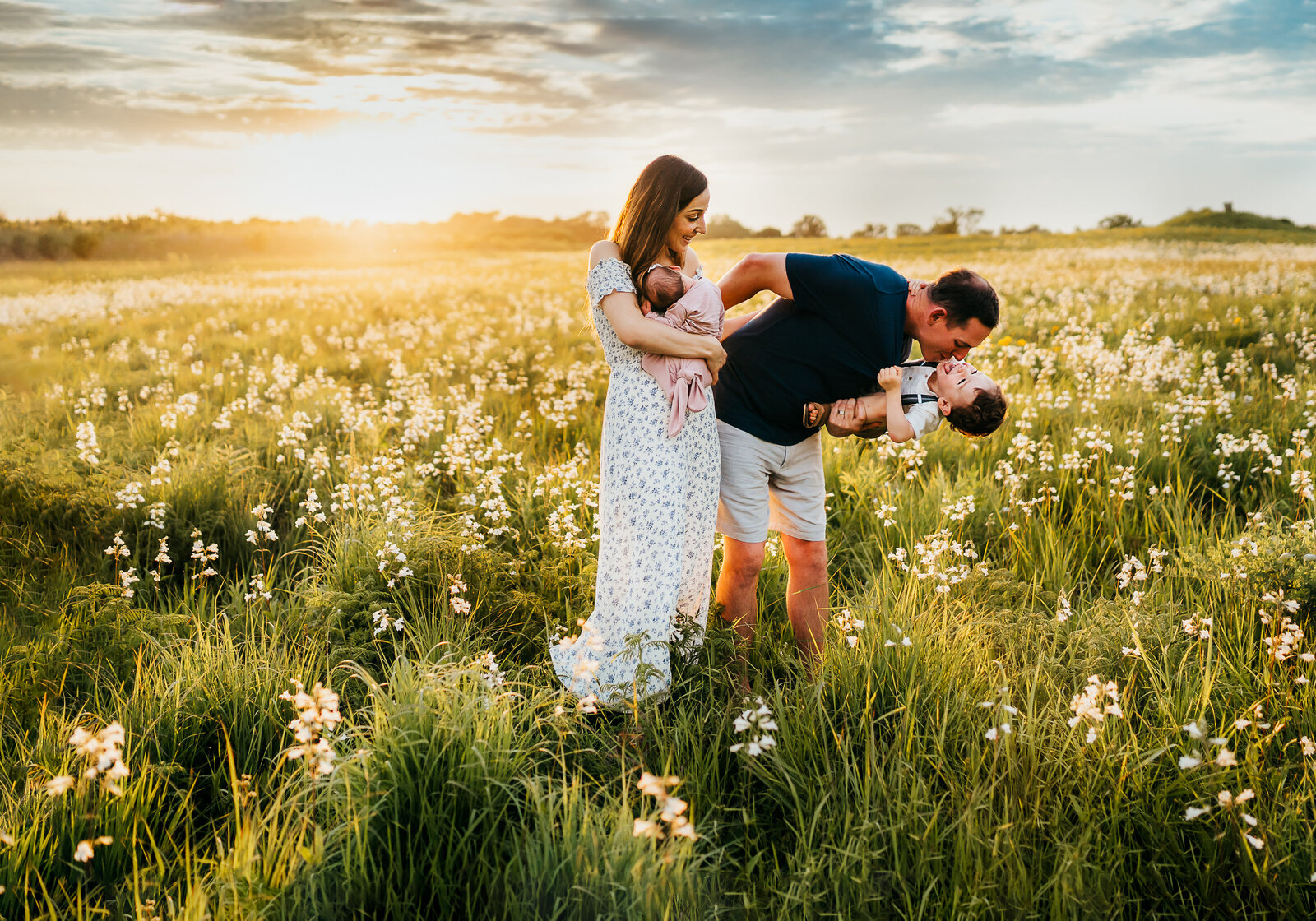 family in flower field at sunset