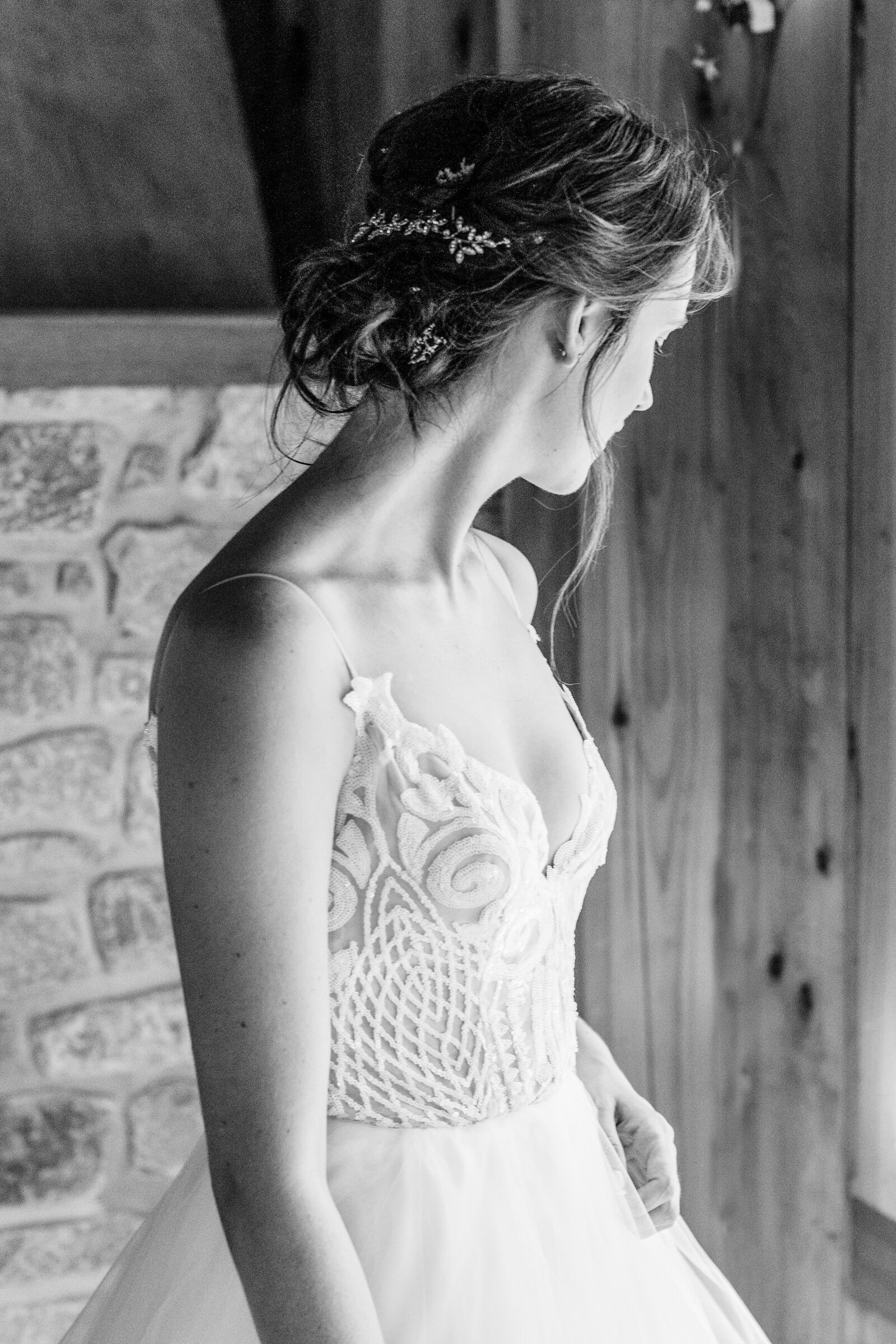 Bride-taking-in-the-moment-when-she-puts-on-her-wedding-dress