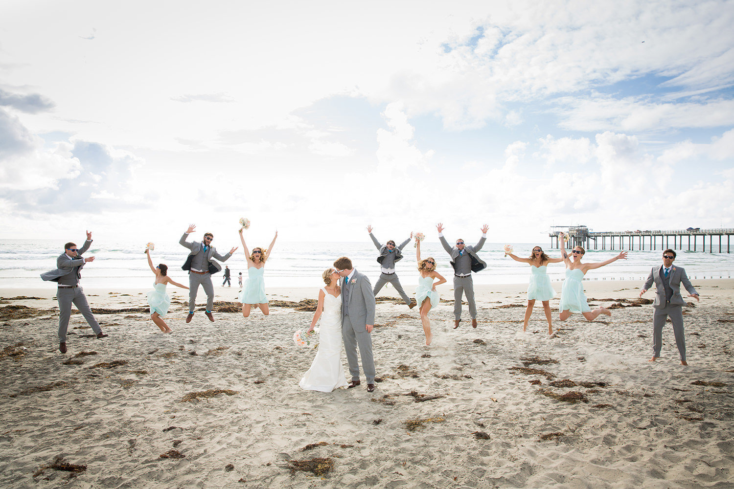 wedding party jumping in the air