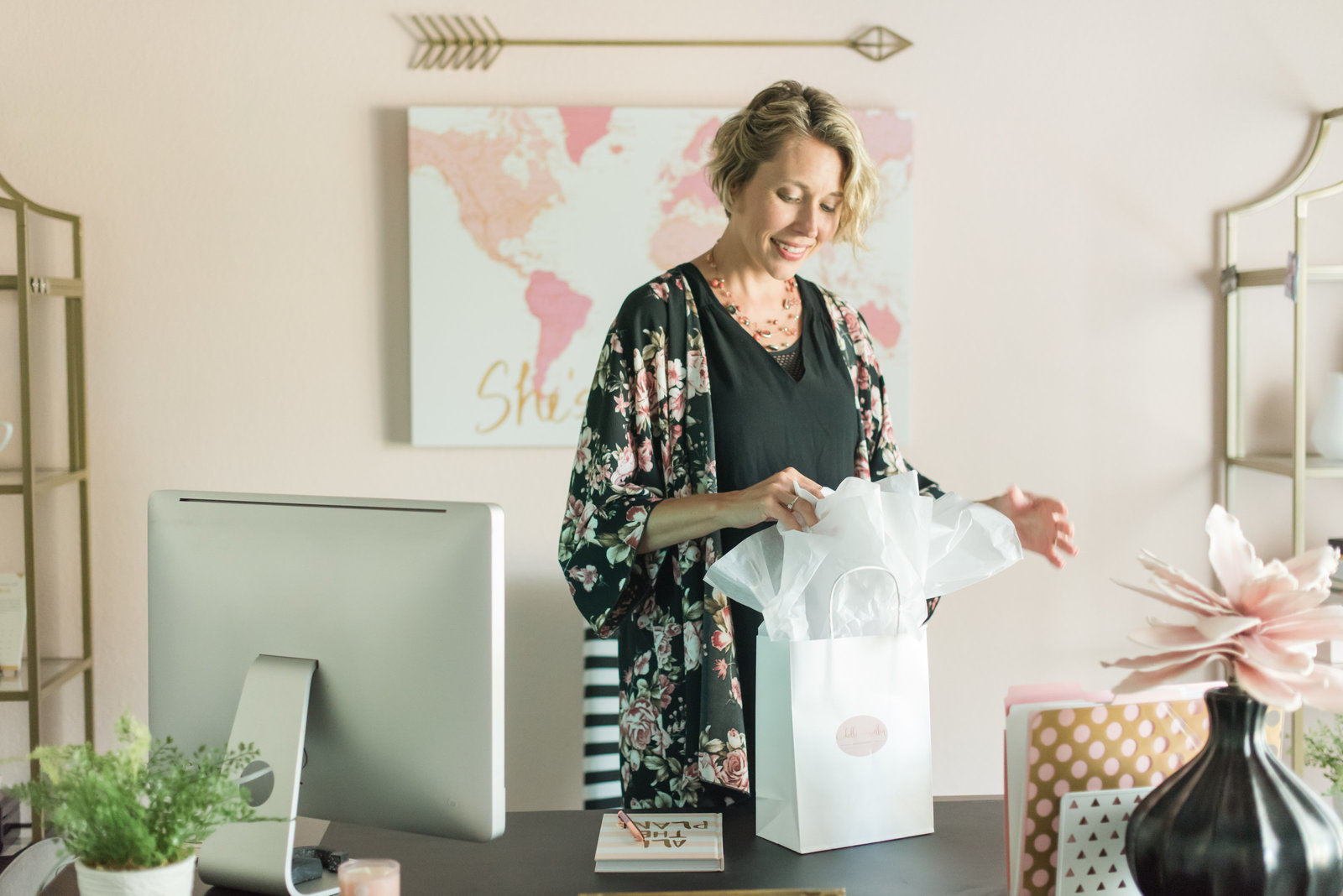 business owner in office packing client gifts