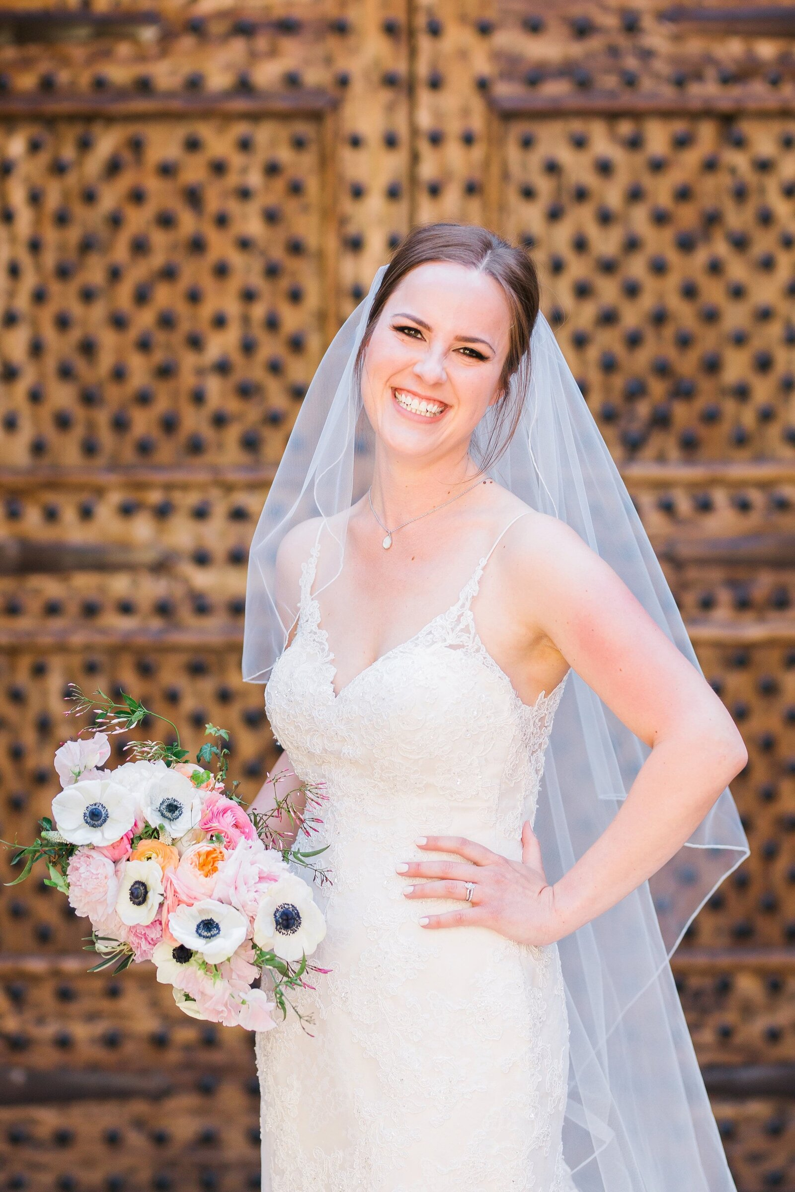 bride-smiling-with-bouquet