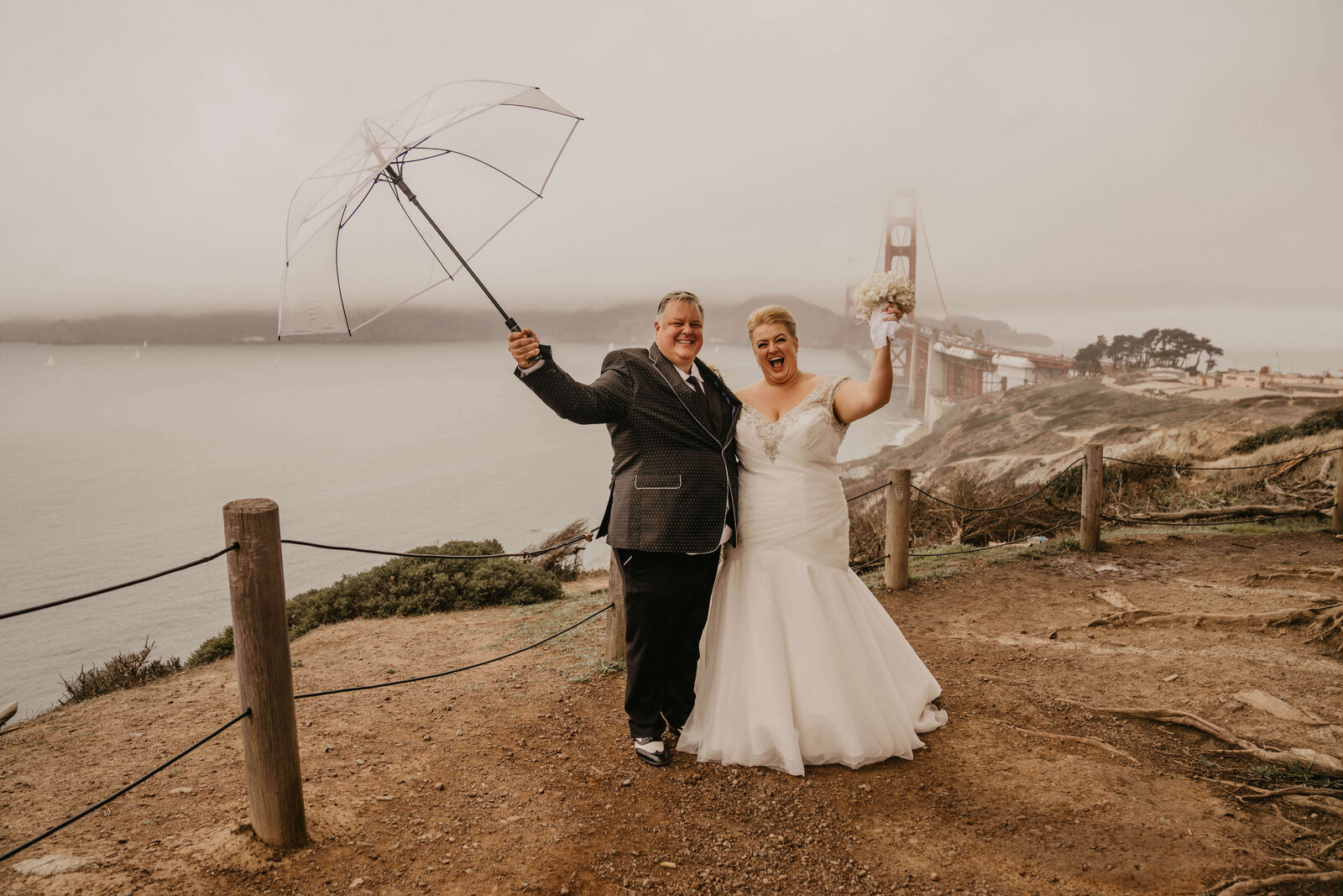 Bride and Groom celebrating just getting married at the Golden Gate Bridge