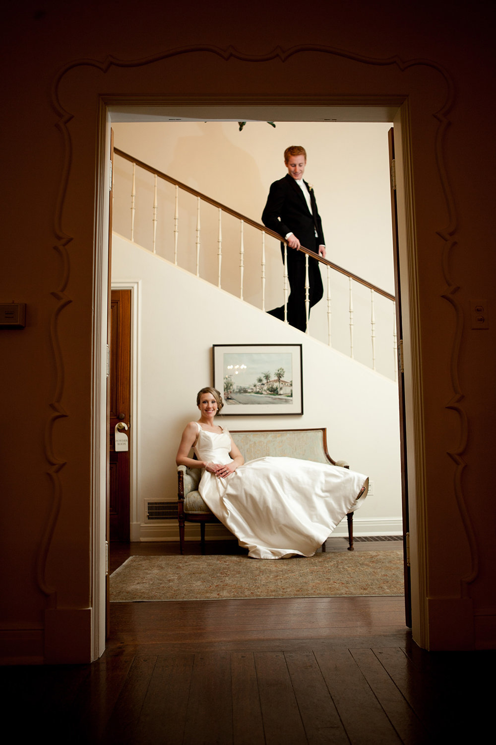 bride and groom on stairs at darlington house