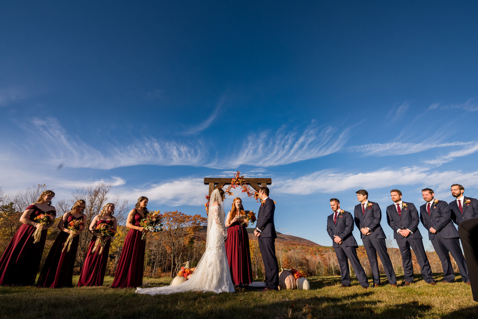 NH Barn wedding with mountain views durng ceremony