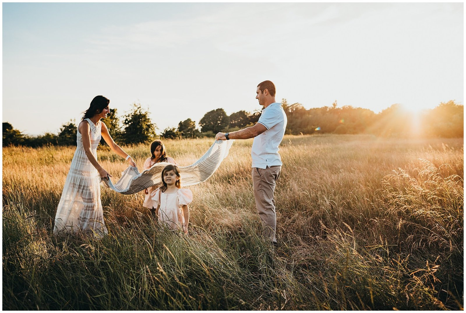 Family playing in field at sunset Emily Ann Photography Seattle Photographer
