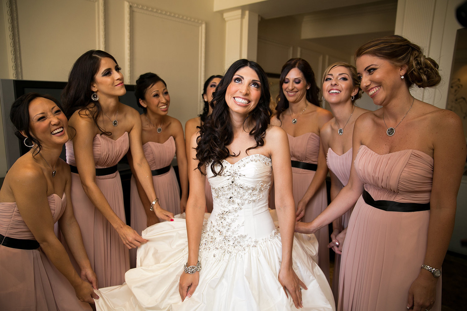 Great natural moment photo of bride and bridesmaids getting ready at a wedding