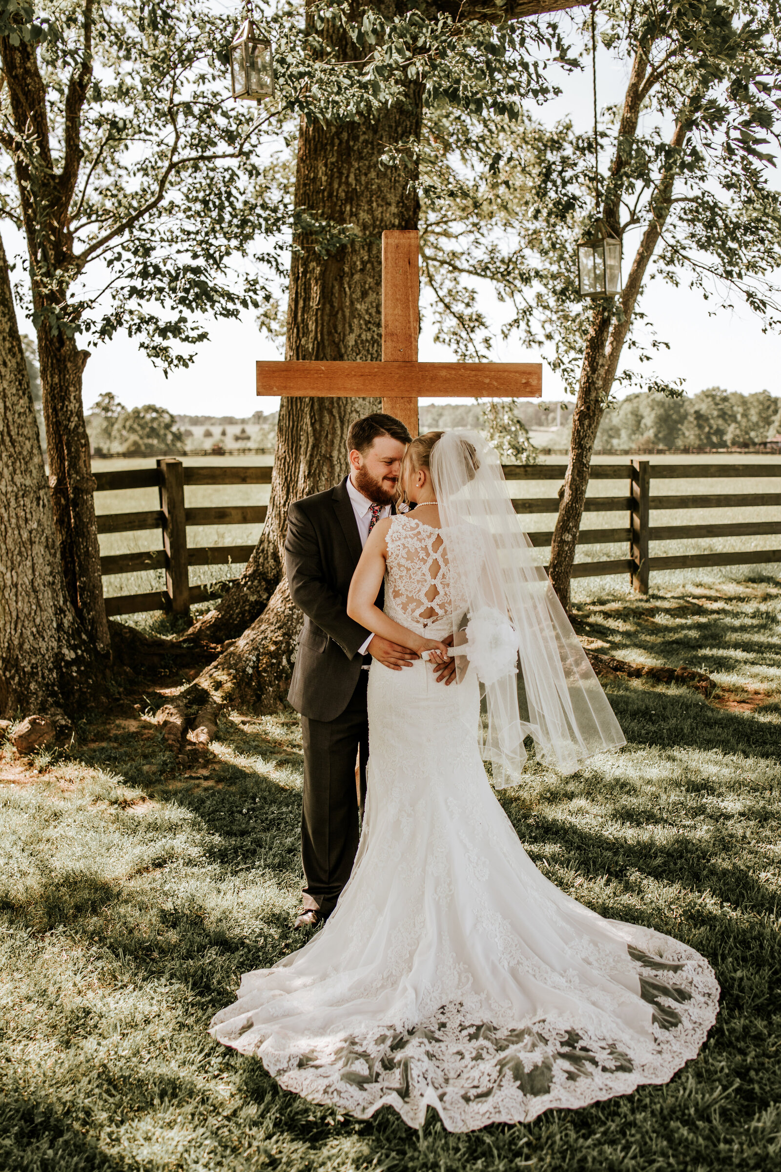 J.Michelle Photography photographs the bride and groom during their portraits at their wedding at Willowick Farm in McDonough, Ga