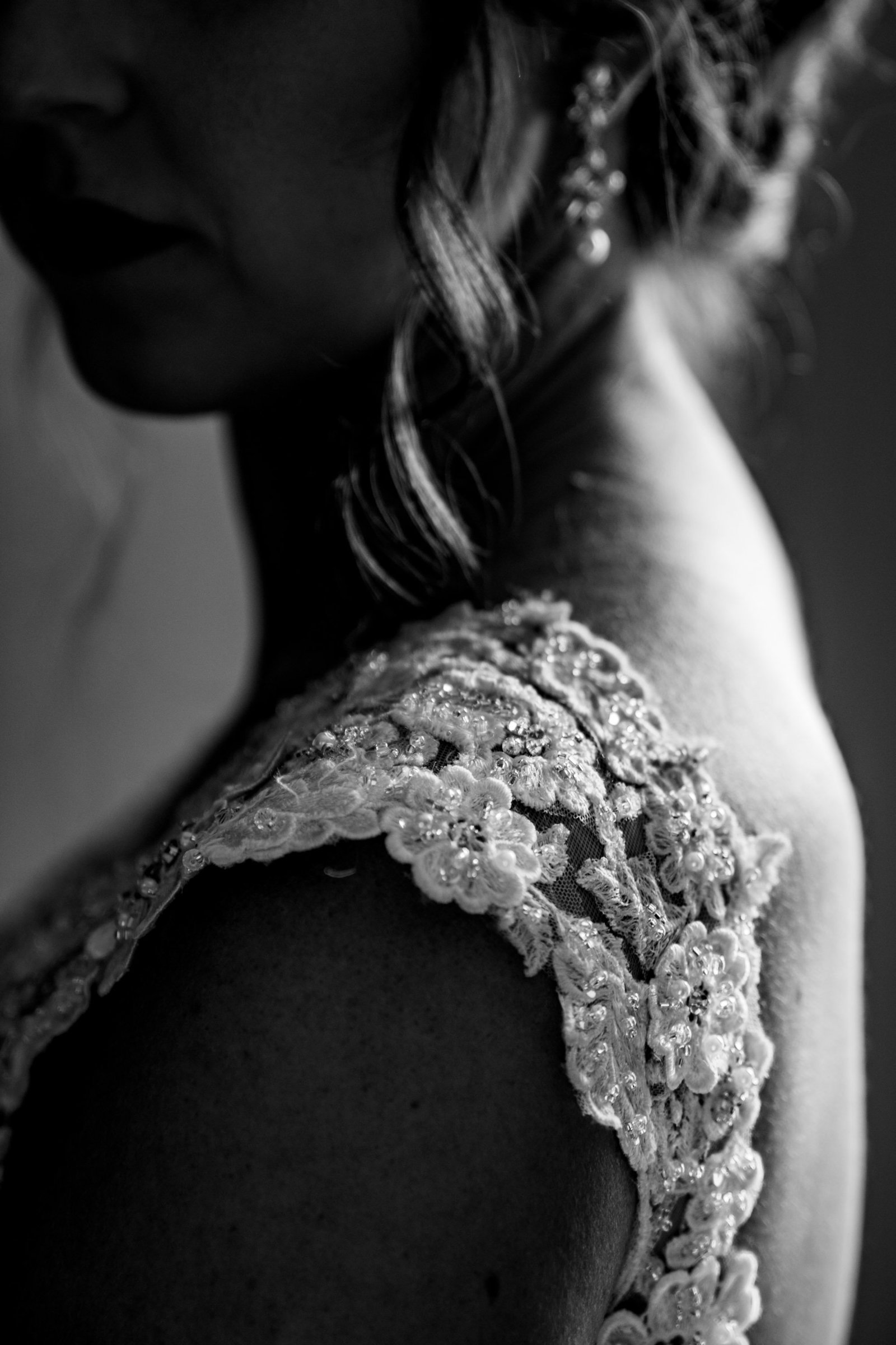 close up of brides lace shoulder