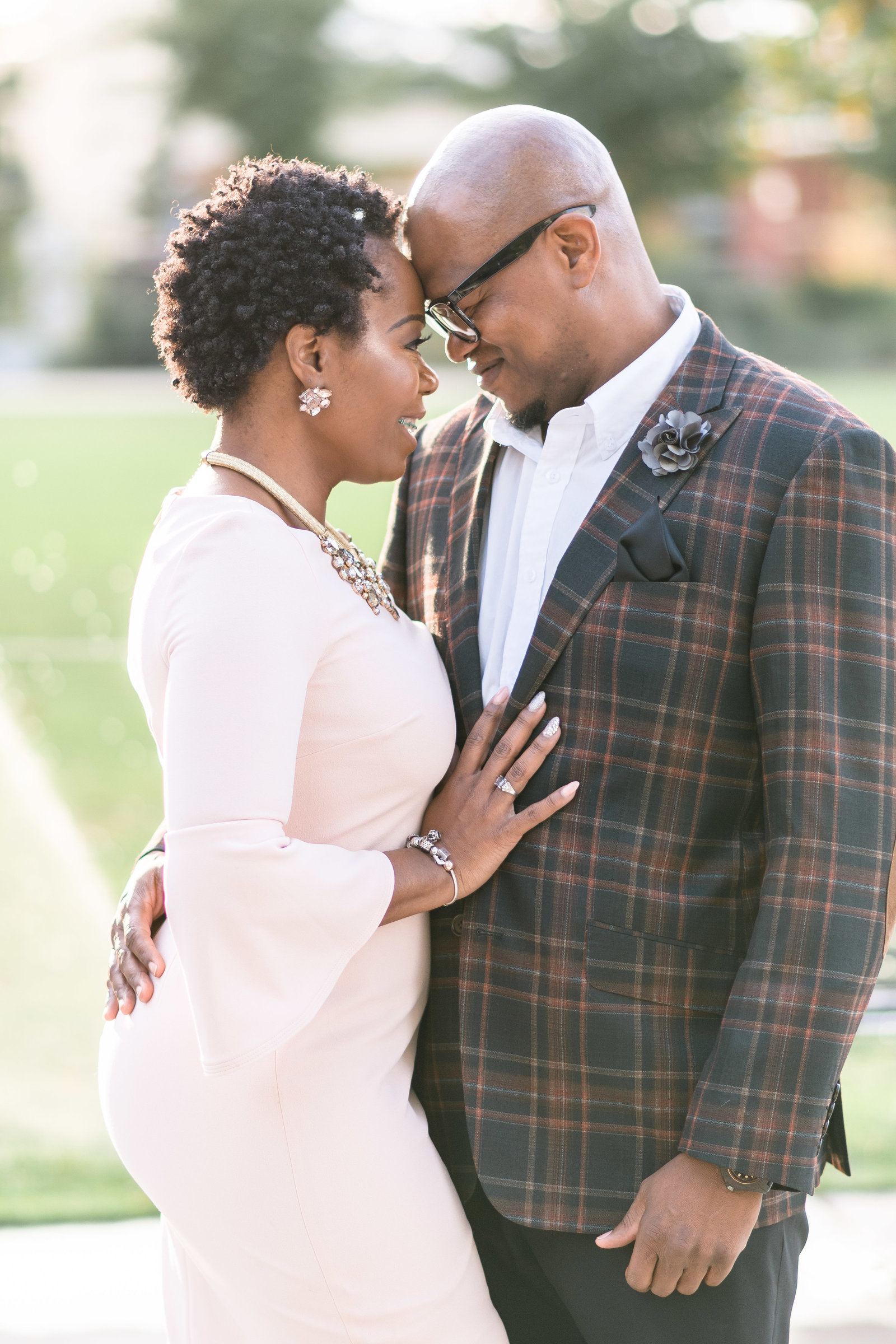 Charlotte engagement photographer shot of couple in Romare Bearden Park in uptown charlotte