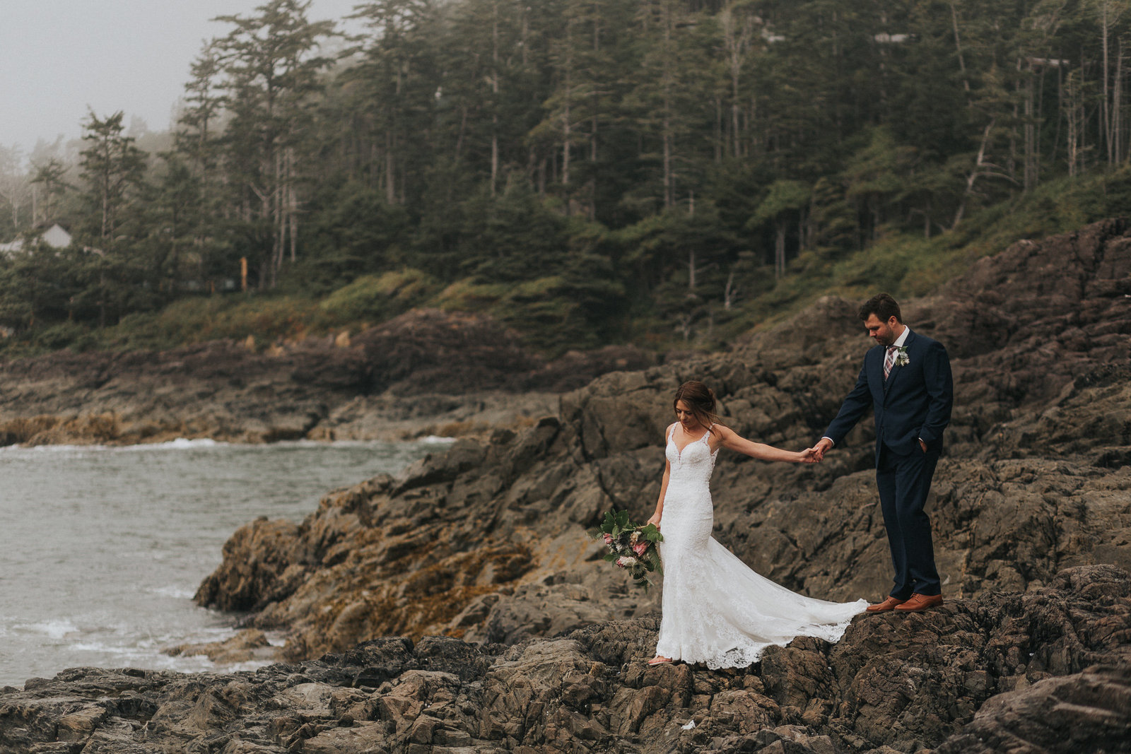 Adventurous bride and groom exploring Tofino beaches