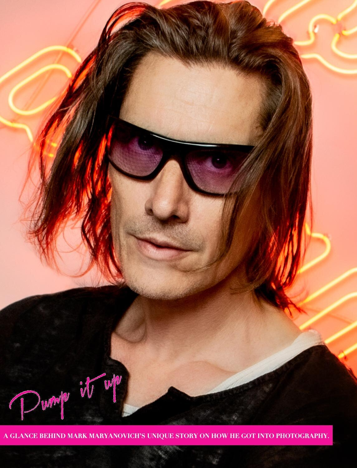 Los Angeles Magazine Interview featuring Photographer Mark Maryanovich self portrait wearing sunglasses against pink background with neon words page 1