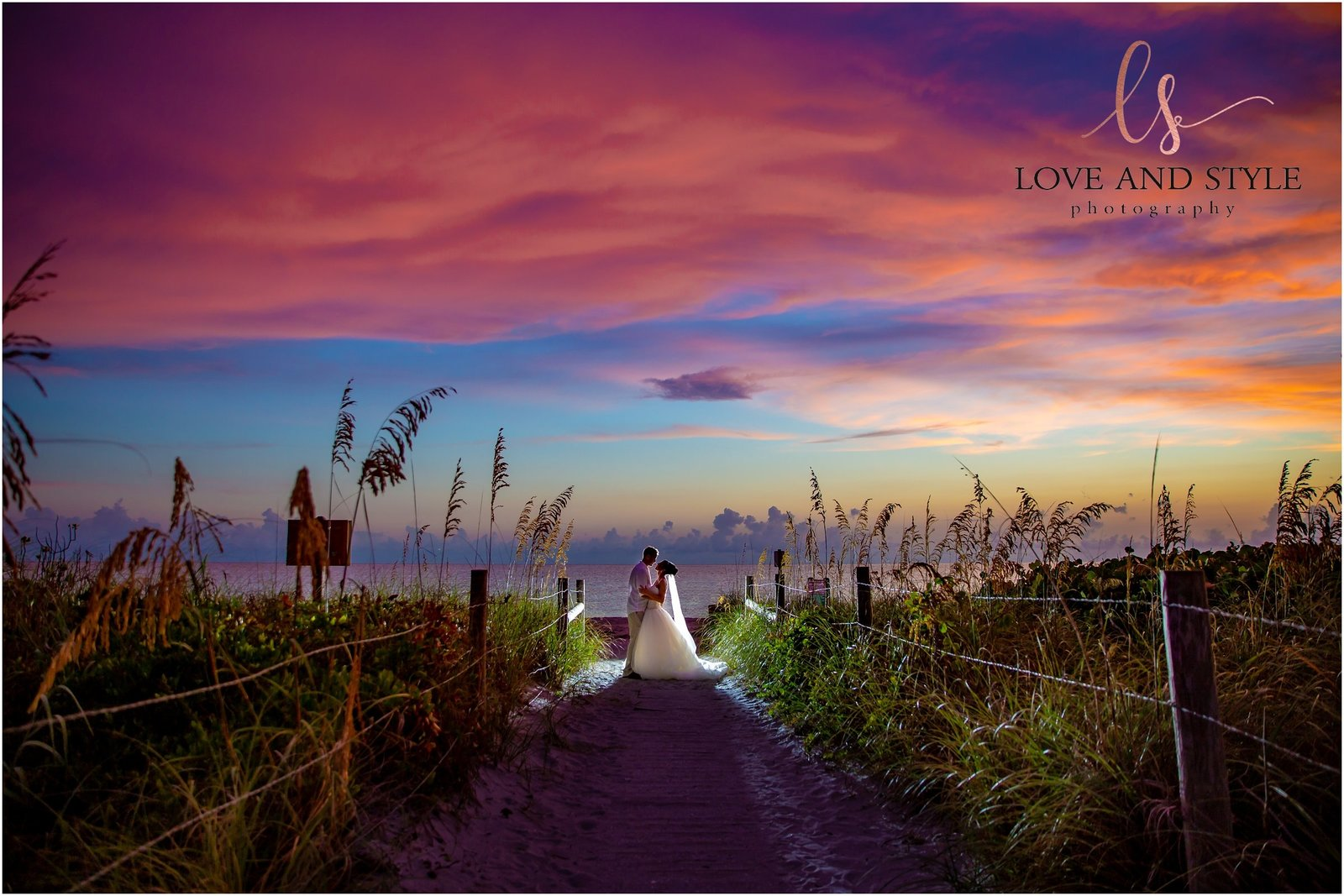 Bride and Groom backlit at sunset on a beach path on Anna Maria Island