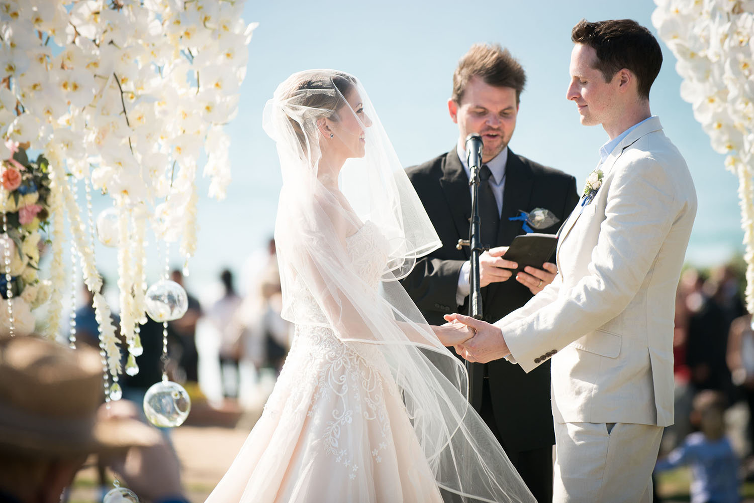 Wedding ceremony with blue skies at Seagrove Park