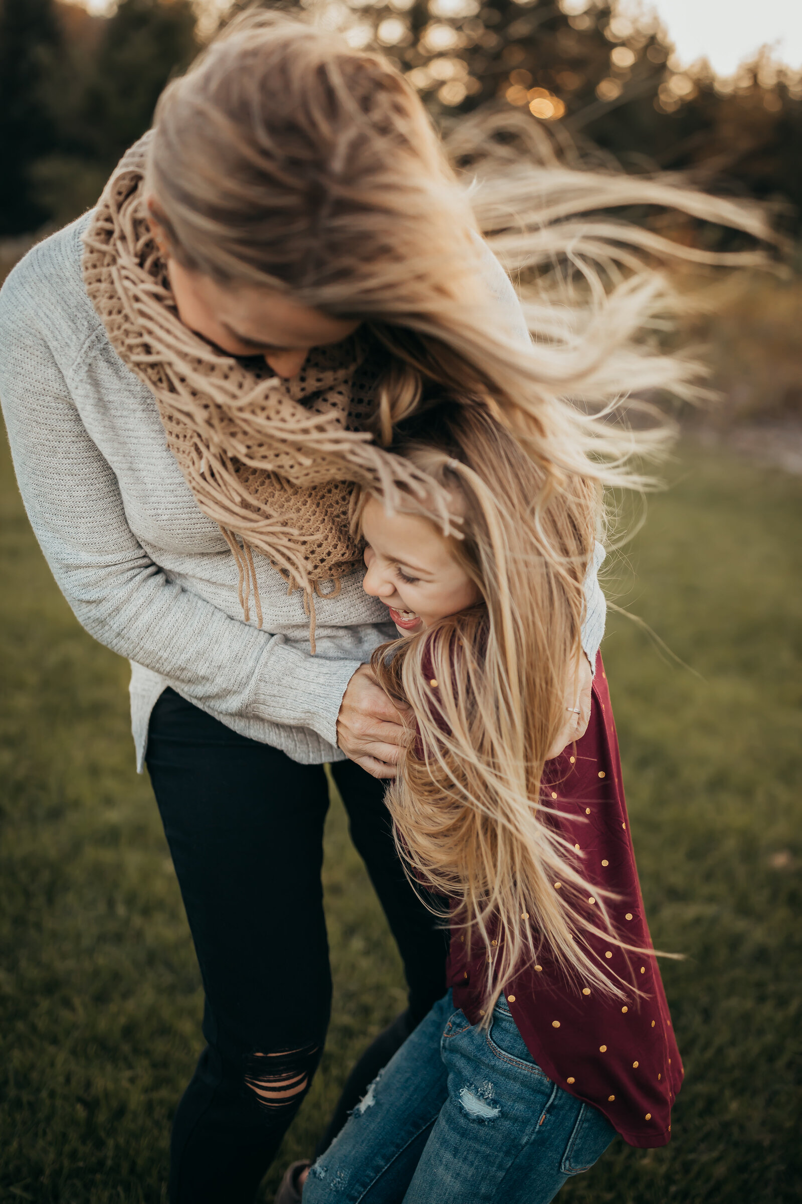 mother daughter laughing blonde