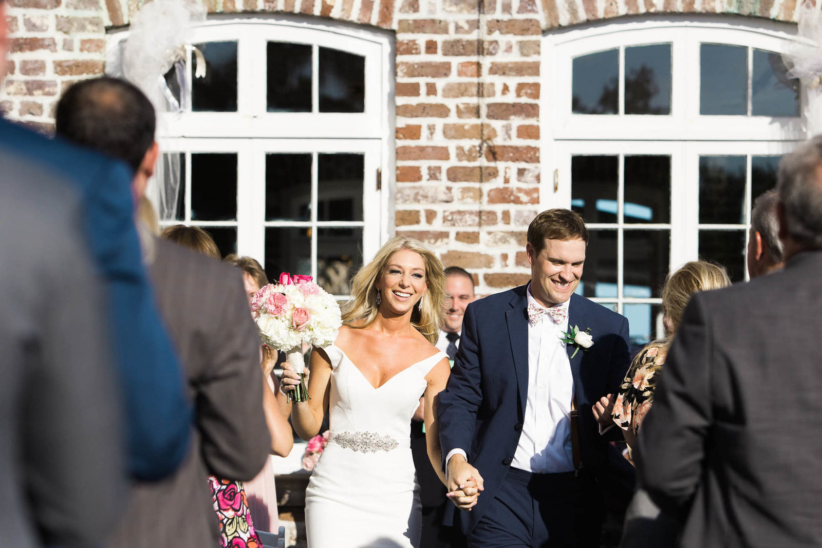 Bride and groom walk down the aisle, Rice Mill Building, Charleston Wedding Photographer.