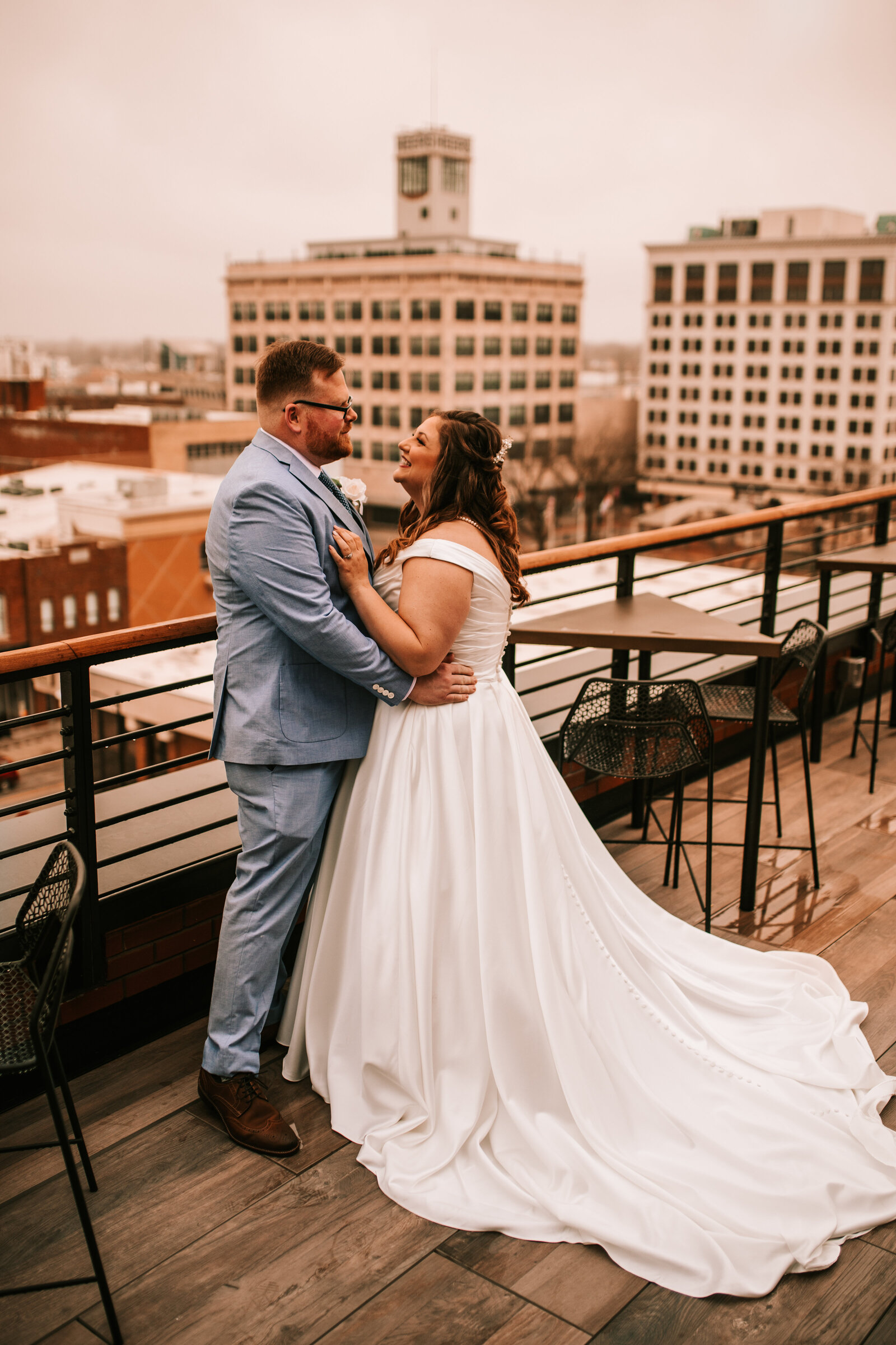 downtown city wedding with city skyline husband and wife bride and groom