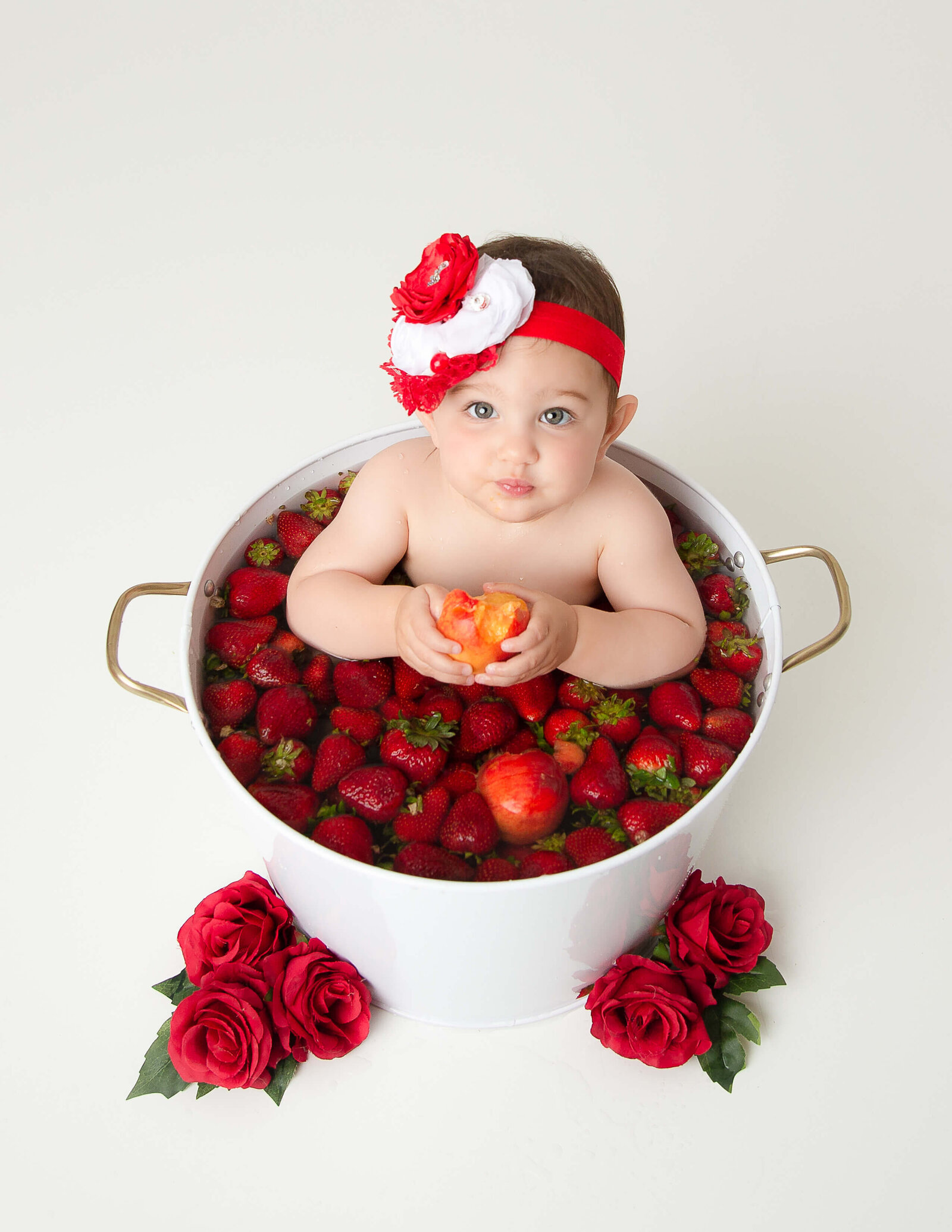 Sweet girl in a fruit bath at our Rochester, Ny studio.