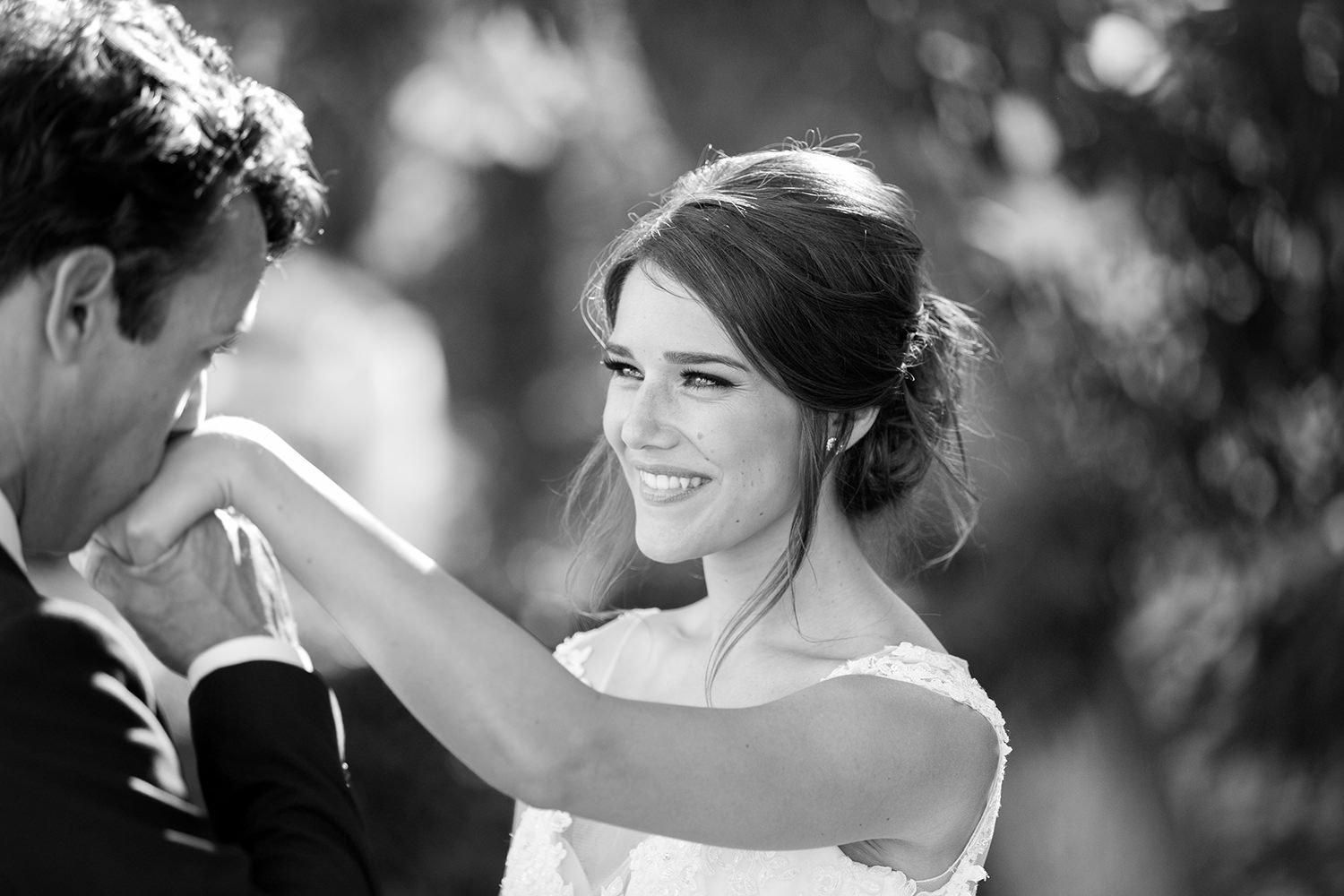 beautiful light with bride and groom at carlton oaks country club close up smiling