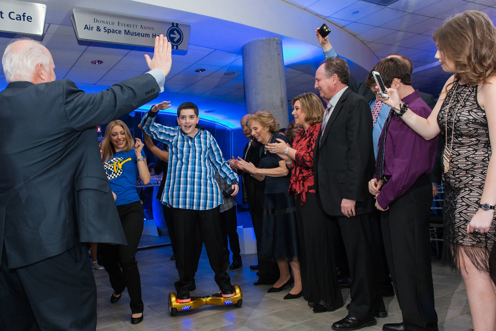Bar mitzvah boy entering room at Cradle of Aviation