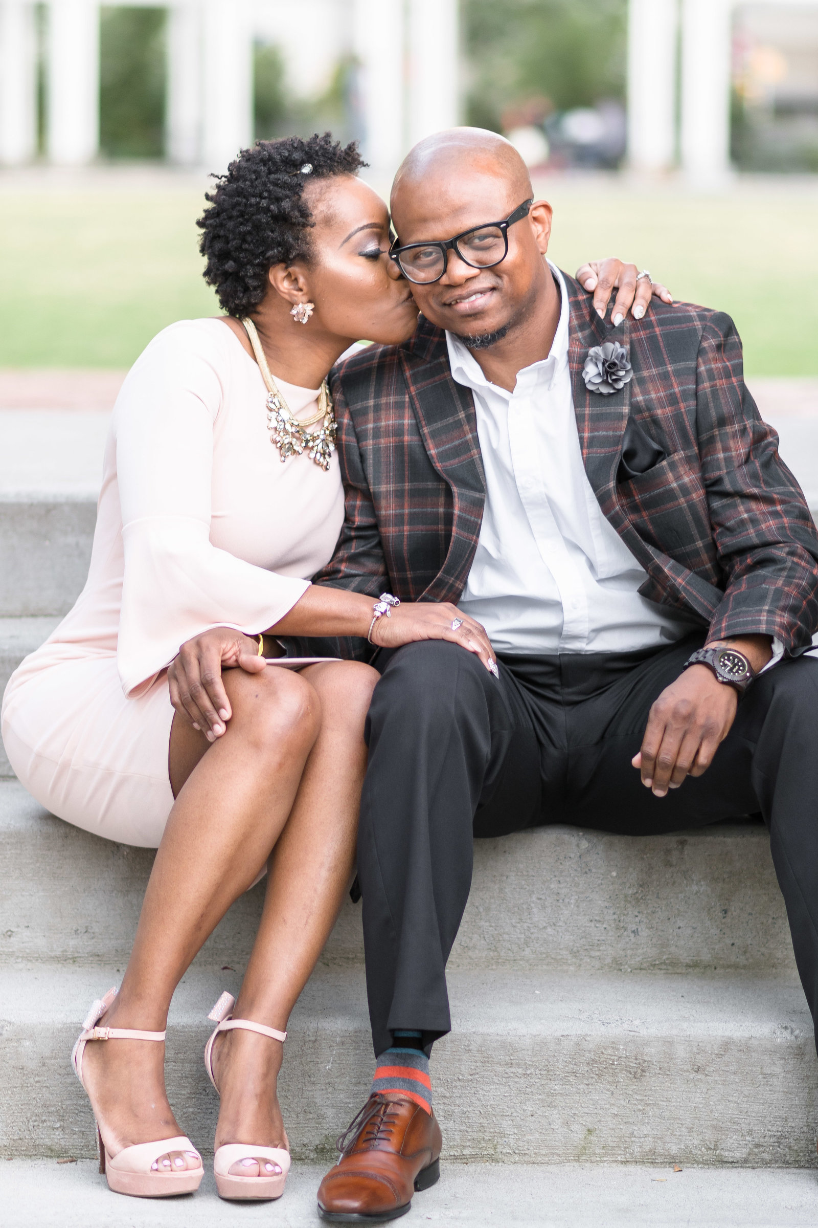 Charlotte engagement photographer shot of couple on stairs in Romare Bearden Park in uptown charlotte
