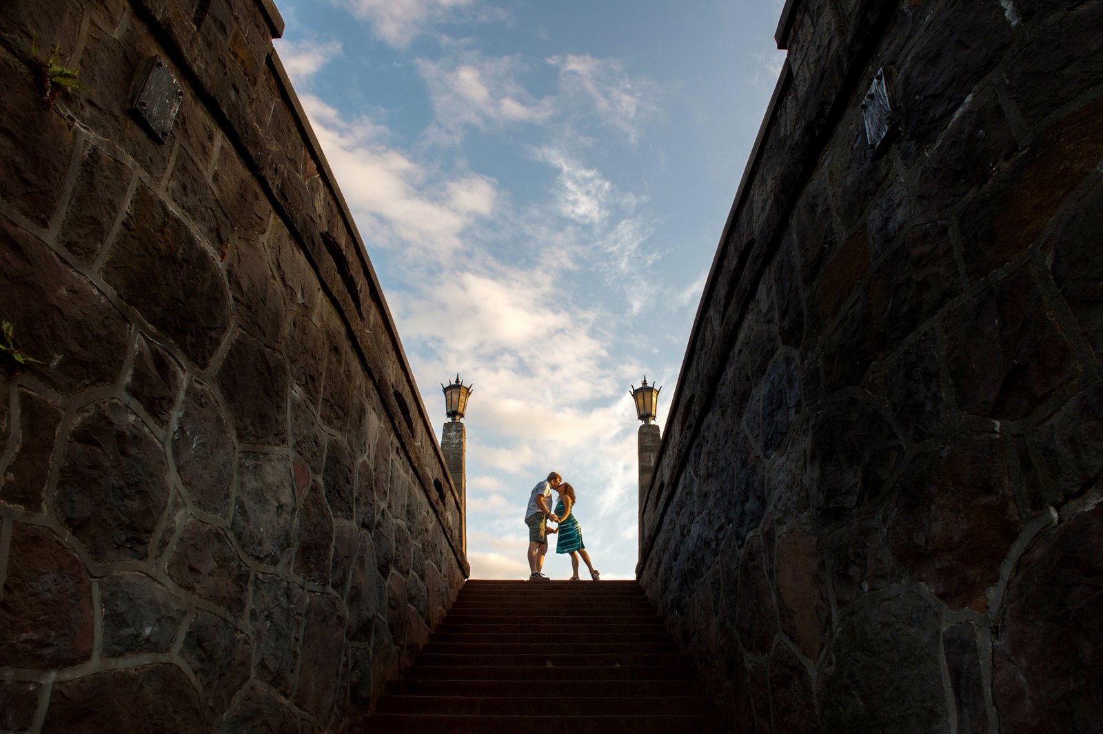 a couple kiss on the top of rocky butte stairs