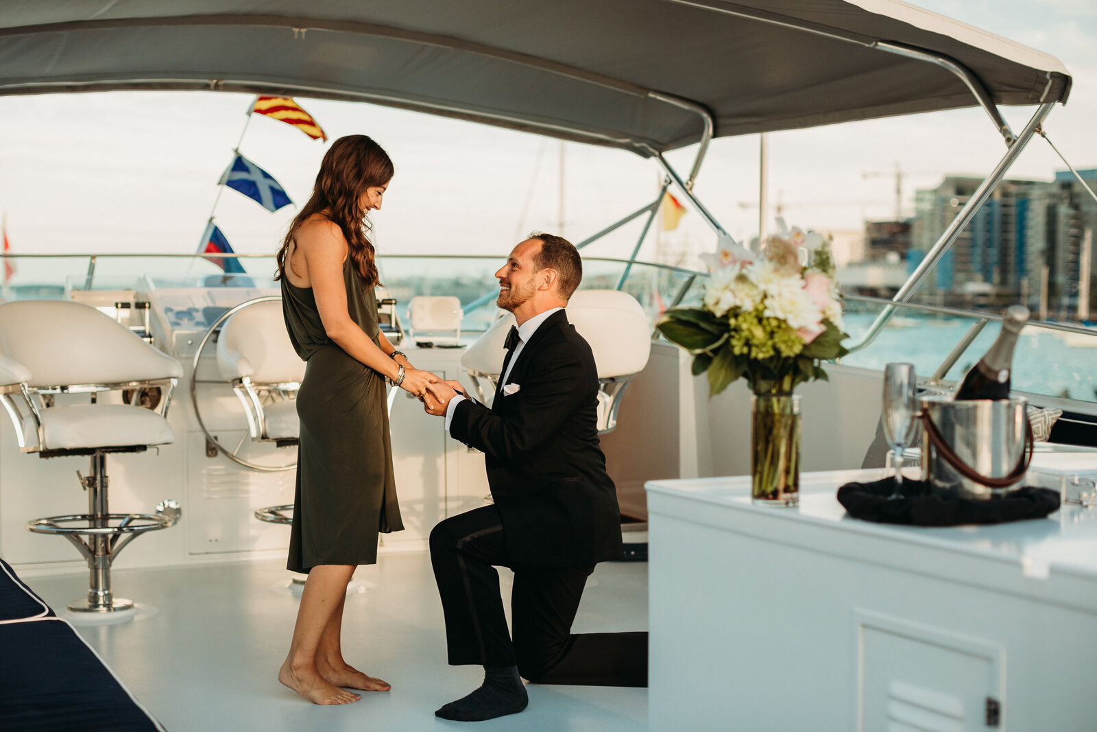 man proposes to woman on a yacht in boston harbor