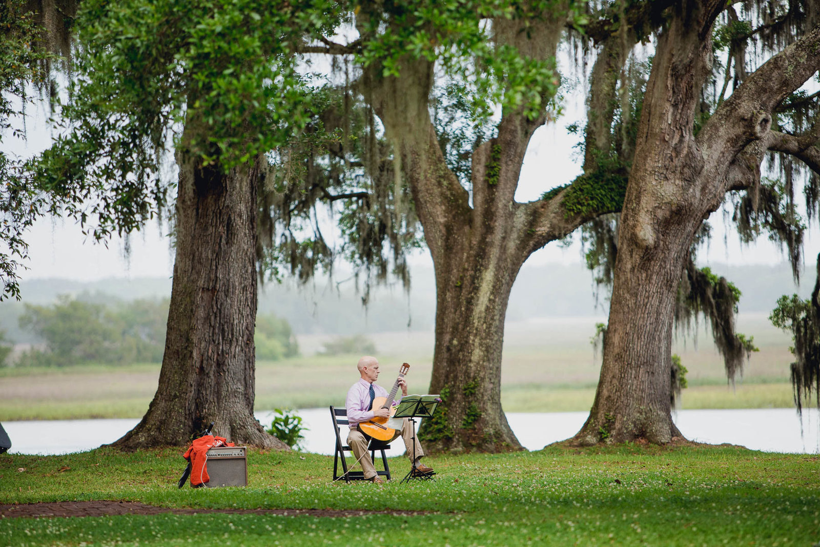 Guitar music is played at ceremony, Old Wide Awake Plantation, Charleston, South Carolina