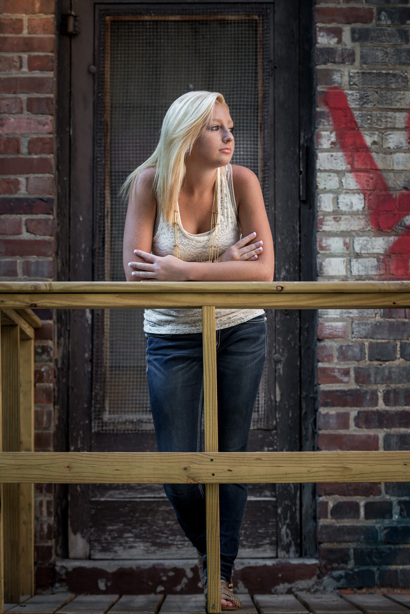 girl-senior-alley-railing