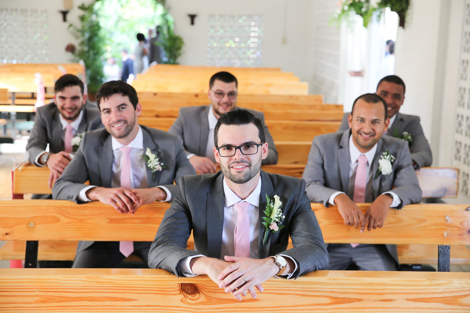 Groom's party in church pews. Photo by Ross Photography, Trinidad, W.I..