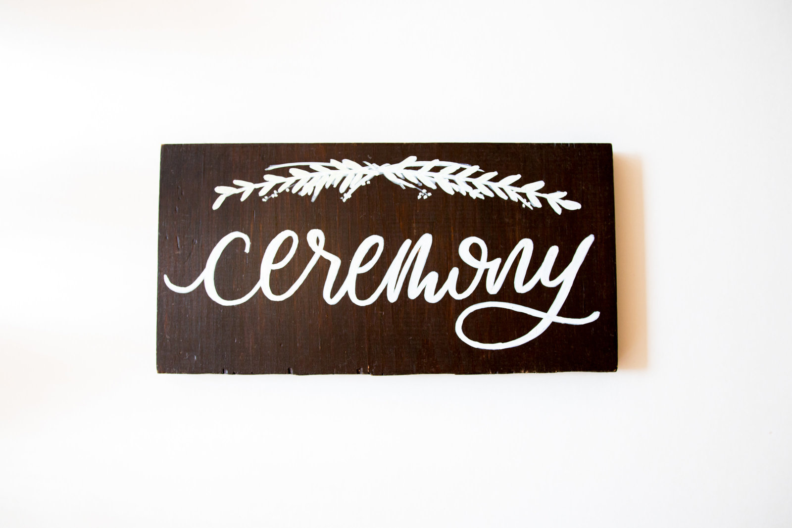 dark wood ceremony sign with white calligraphy for wedding with Hue + FA rentals