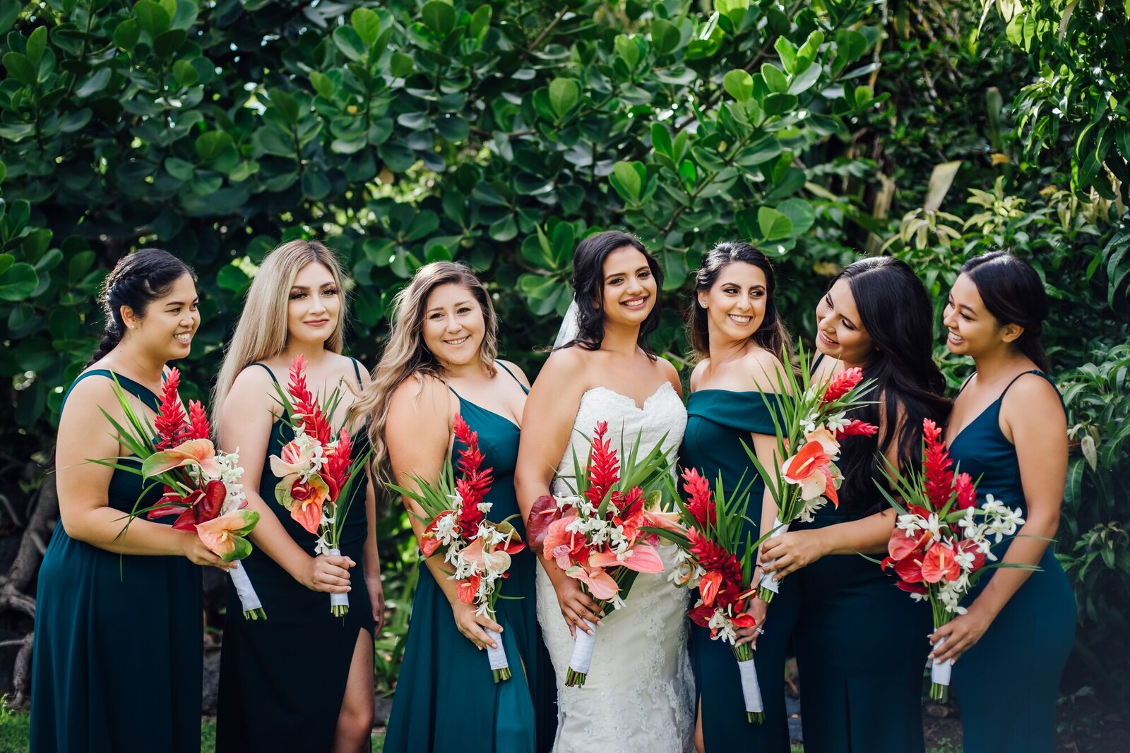 bride and bridesmaids with vibrant flowers